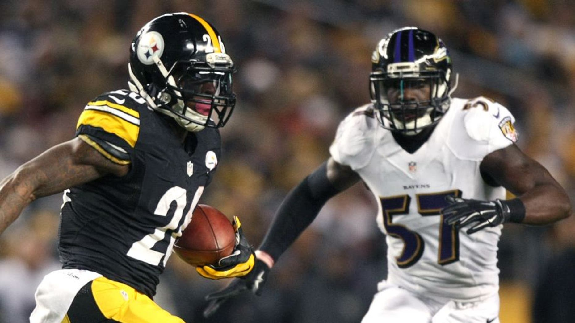 Nov 2, 2014; Pittsburgh, PA, USA; Pittsburgh Steelers running back Le'Veon Bell (26) runs the ball against Baltimore Ravens linebacker C.J. Mosley (57) during the first half of the game at Heinz Field. Mandatory Credit: Jason Bridge-USA TODAY Sports