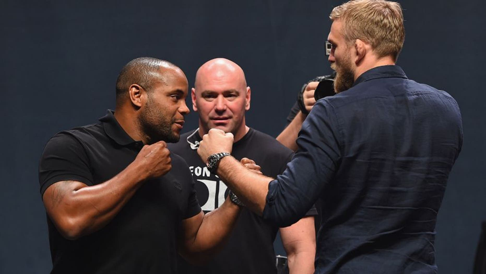 LAS VEGAS, NV - SEPTEMBER 04: (L-R) UFC light heavyweight champion Daniel Cormier and Alex Gustafsson face off during the UFC's Go Big launch event inside MGM Grand Garden Arena on September 4, 2015 in Las Vegas, Nevada. (Photo by Josh Hedges/Zuffa LLC/Zuffa LLC via Getty Images)