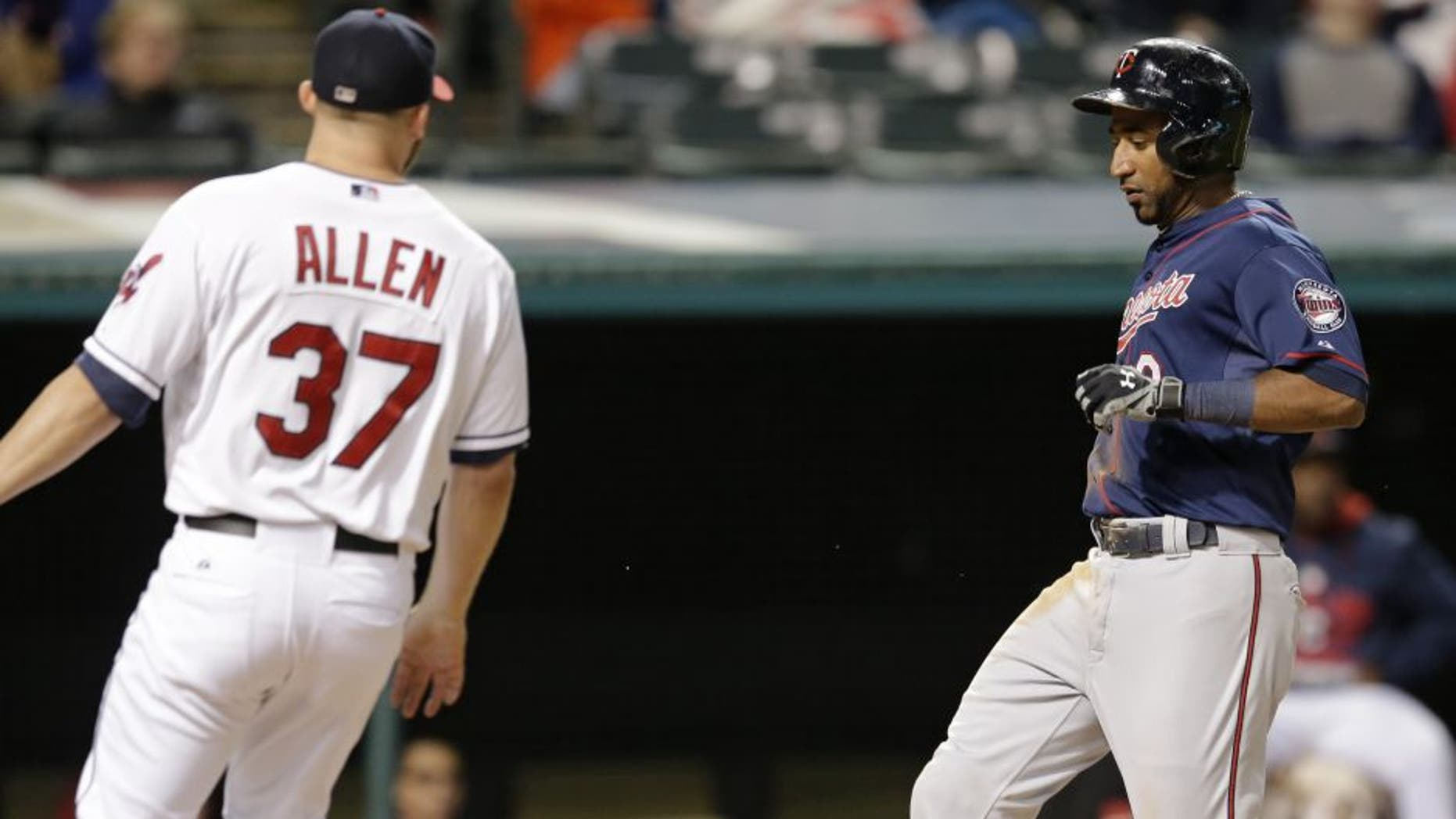 Minnesota Twins' Eduardo Nunez scores on a wild pitch by Cleveland Indians relief pitcher Cody Allen in the ninth inning
