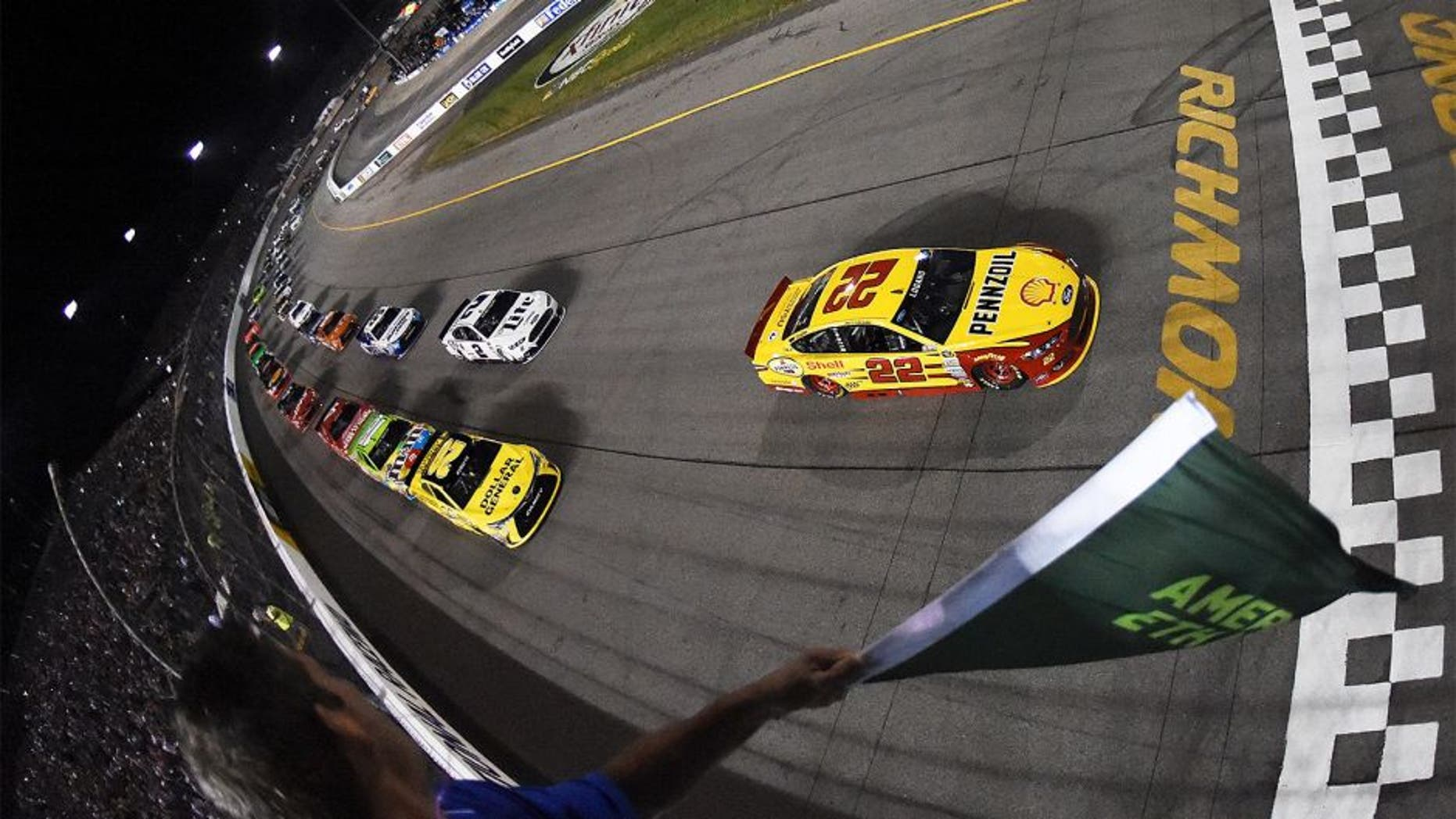 RICHMOND, VA - SEPTEMBER 12: Joey Logano, driver of the #22 Shell Pennzoil Ford, leads the field to the green flag to start the NASCAR Sprint Cup Series Federated Auto Parts 400 at Richmond International Raceway on September 12, 2015 in Richmond, Virginia. (Photo by Rainier Ehrhardt/NASCAR via Getty Images)