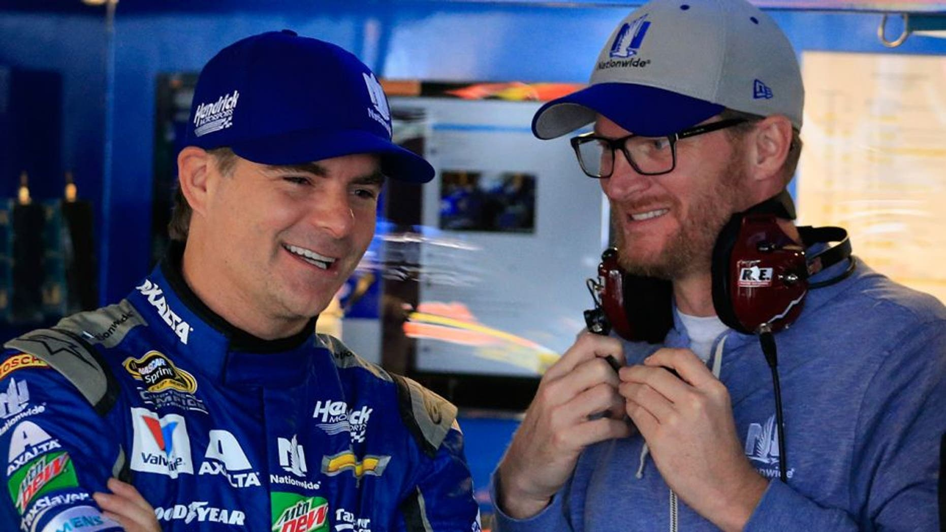 DOVER, DE - OCTOBER 01: Jeff Gordon (L), driver of the #88 Nationwide Chevrolet, talks with NASCAR Sprint Cup Series driver Dale Earnhardt Jr. in the garage area during practice for the NASCAR Sprint Cup Series Citizen Solider 400 at Dover International Speedway on October 1, 2016 in Dover, Delaware. (Photo by Chris Trotman/Getty Images)