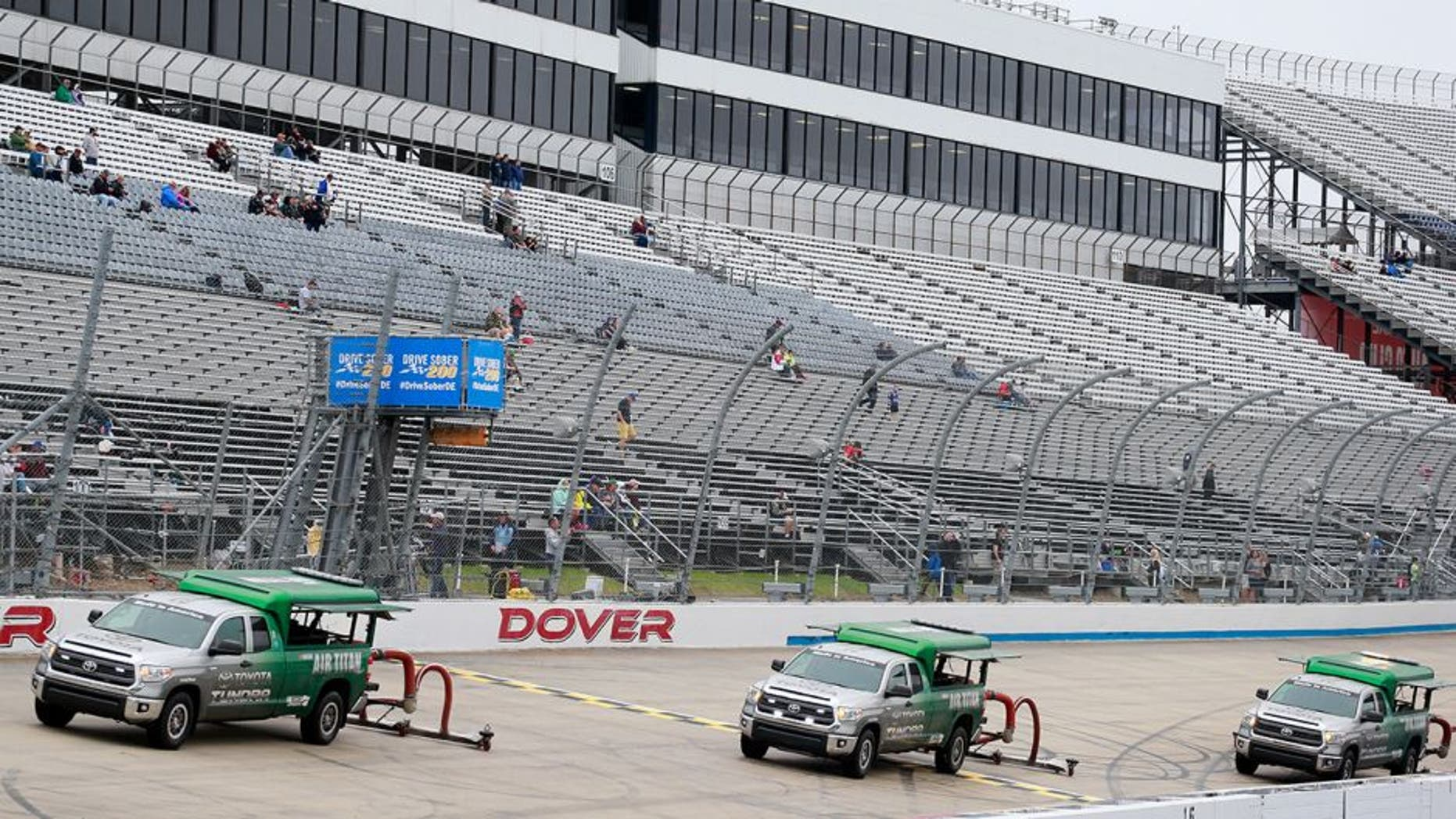 DOVER, DE - OCTOBER 01: Air Titan 2.0 trucks work to dry the track after qualifying for the NASCAR XFINITY Series Drive Sober 200 at Dover International Speedway on October 1, 2016 in Dover, Delaware. (Photo by Matt Sullivan/Getty Images)