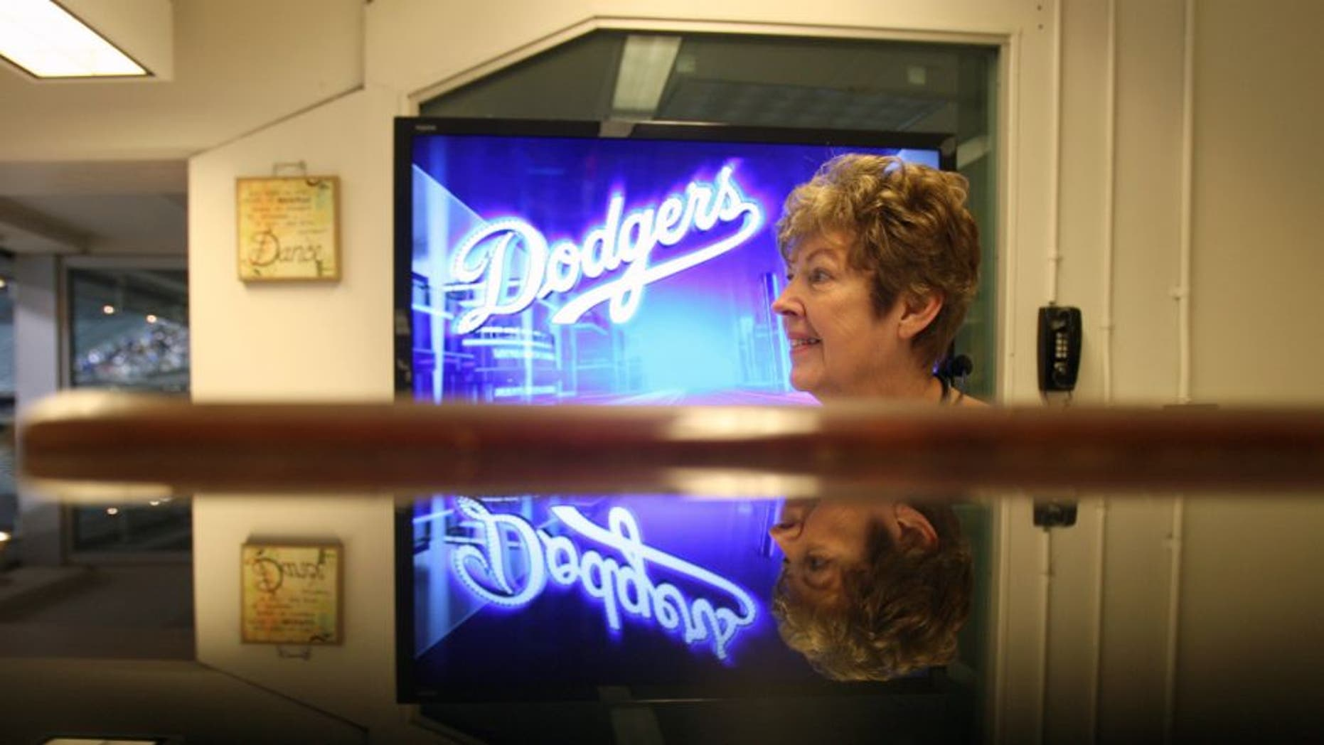 7:38pm April 4: Organist Nancy Bea Hefley watches the game for musical cues during the Dodgers– Angels exhibition Freeway Series game. Hefley has been playing since the late 1980s alongside announcers Rick Monday and Vin Scully and became one of the crowd favorites at Dodger Stadium. She plays popular pop and rock songs as well as older and less commonly played numbers. (Photo by Allen J. Schaben/Los Angeles Times via Getty Images)