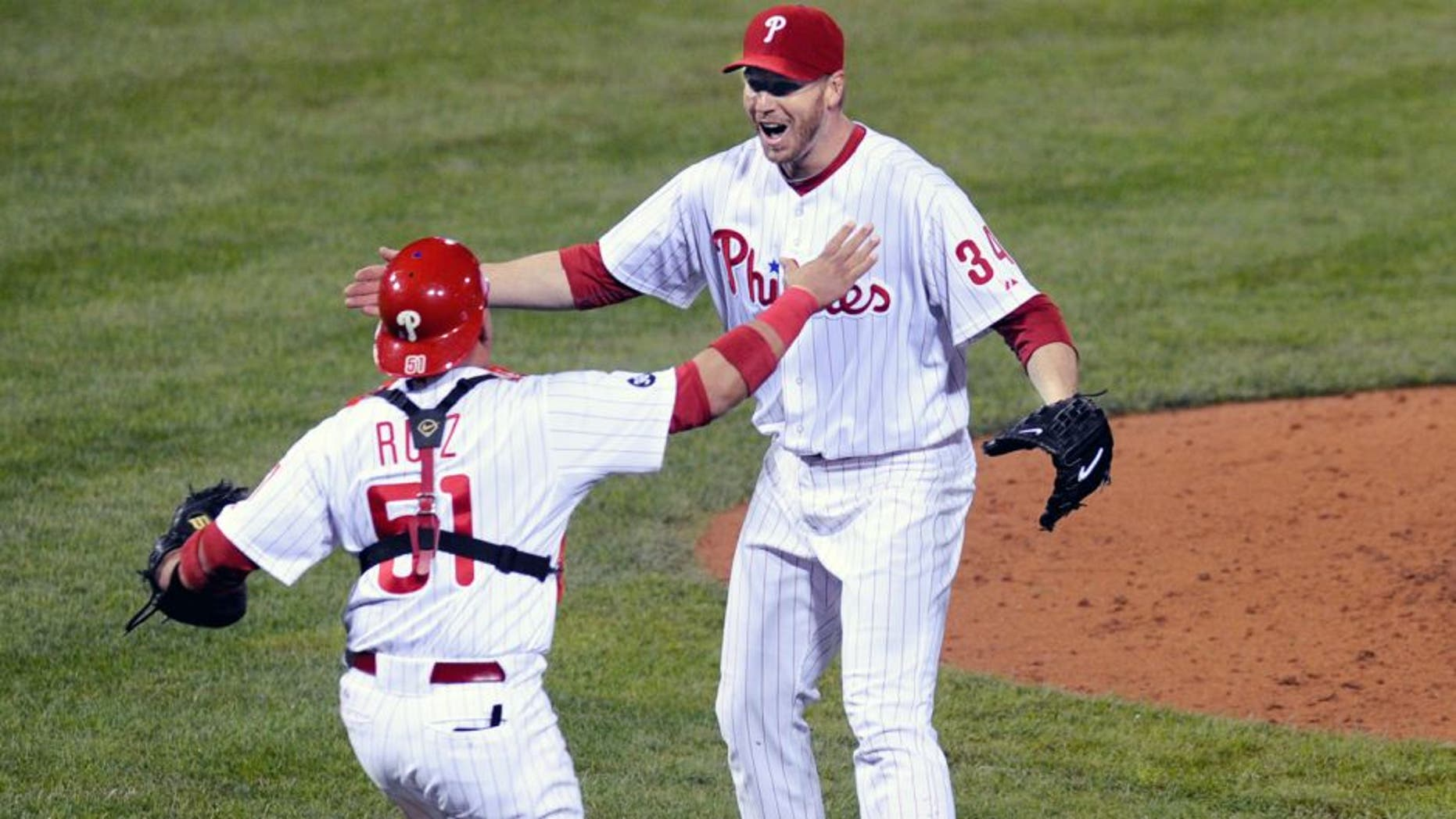 PHILADELPHIA - OCTOBER 06: Roy Halladay #34 of the Philadelphia Phillies celebrates with Carlos Ruiz #51 after throwing a no hitter against the Cincinnati Reds on October 6, 2010 during Game 1 of the NLDS at Citizens Bank Park in Philadelphia, Pennsylvania. The Phillies defeated the Reds 4-0. (Photo by: Rob Tringali/SportsChrome/Getty Images) *** Local Caption *** Roy Halladay;Carlos Ruiz