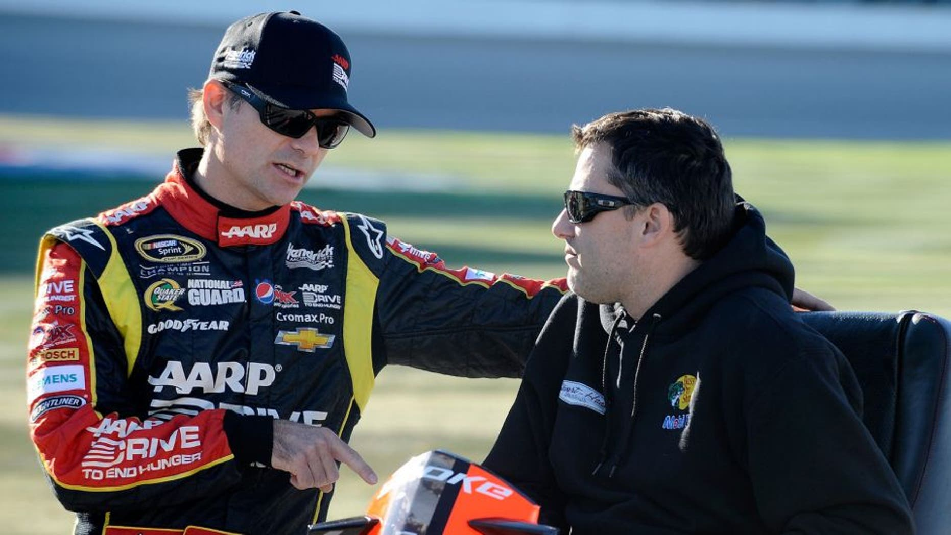 JOLIET, IL - SEPTEMBER 13: Jeff Gordon, driver of the #24 Drive To End Hunger Chevrolet, speaks with Tony Stewart during qualifying for the NASCAR Sprint Cup Series Geico 400 at Chicagoland Speedway on September 13, 2013 in Joliet, Illinois. (Photo by Rainier Ehrhardt/NASCAR via Getty Images)