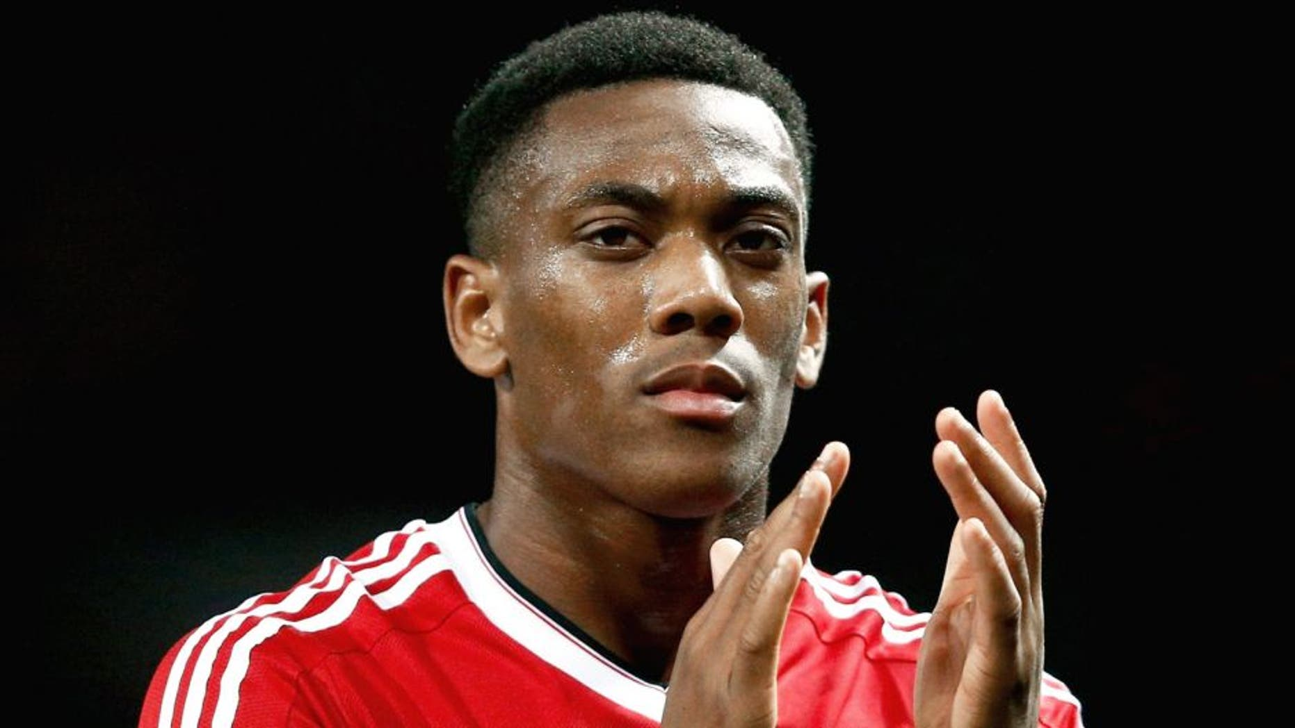MANCHESTER, ENGLAND - SEPTEMBER 30: Anthony Martial of Manchester United applauds the crowd after victory in the UEFA Champions League Group B match between Manchester United FC and VfL Wolfsburg at Old Trafford on September 30, 2015 in Manchester, United Kingdom. (Photo by Dean Mouhtaropoulos/Getty Images)