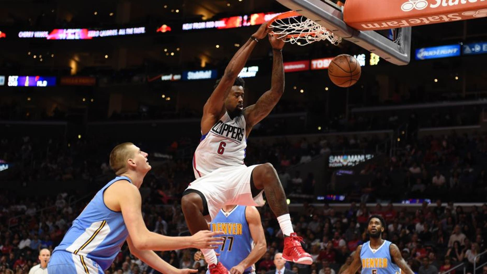 Oct 2, 2015; Los Angeles, CA, USA; Los Angeles Clippers center DeAndre Jordan (6) dunks against the Denver Nuggets during the second half at Staples Center. Mandatory Credit: Richard Mackson-USA TODAY Sports
