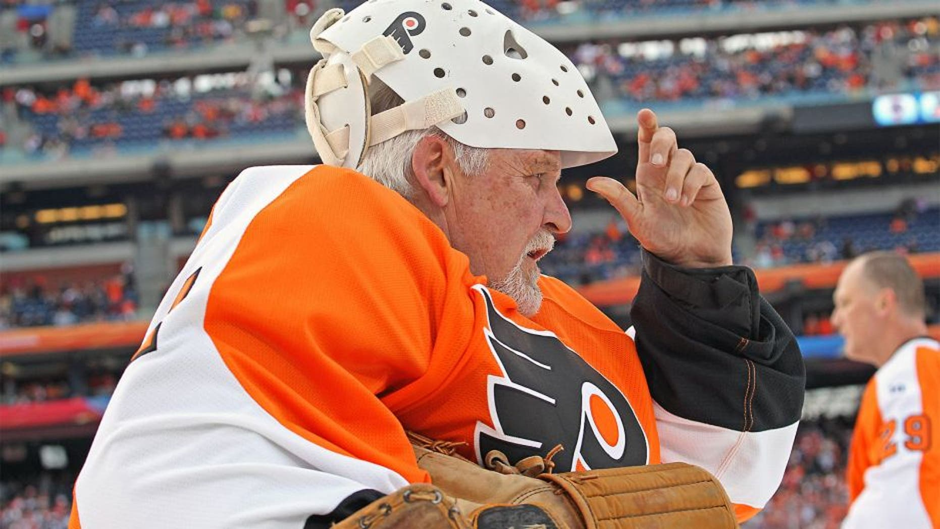 PHILADELPHIA, PA - DECEMBER 31: Bernie Parent #1 of the Philadelphia Flyers looks on during warmups prior to his game against the New York Rangers during the Alumni Game prior to the 2012 NHL Bridgestone Winter Classic on December 31, 2011 at Citizens Bank Park in Philadelphia, Pennsylvania. (Photo by Len Redkoles/NHLI via Getty Images)