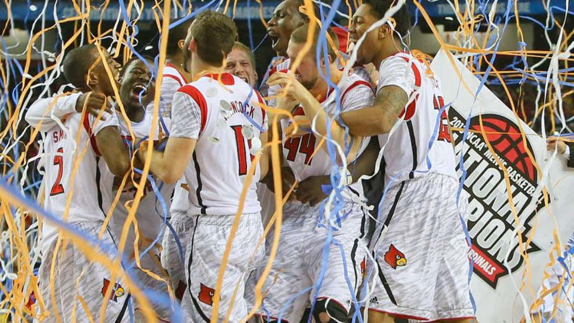 Louisville celebrates defeating Michigan to win the NCAA Division I National Championship on Monday, April 8, 2013, in Atlanta. Louisville beat Michigan 82-76.