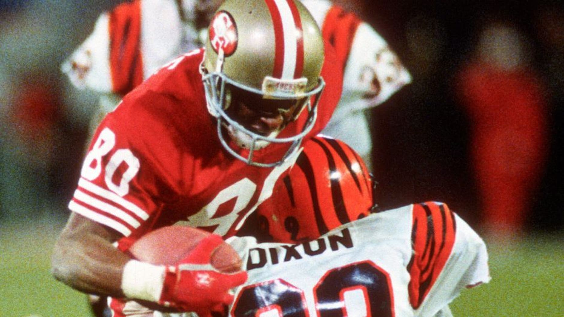 MIAMI, FL- JANUARY 22: Jerry Rice #80 of the San Francisco 49ers gets tackled by Rickey Dixon #29 of the Cincinnati Bengals during Super Bowl XXIII on January 22, 1989 at Joe Robbie Stadium in Miami, Florida. The 49ers won the Super Bowl 20-16. (Photo by Focus on Sport/Getty Images) *** Local Caption *** Jerry Rice; Rickey Dixon