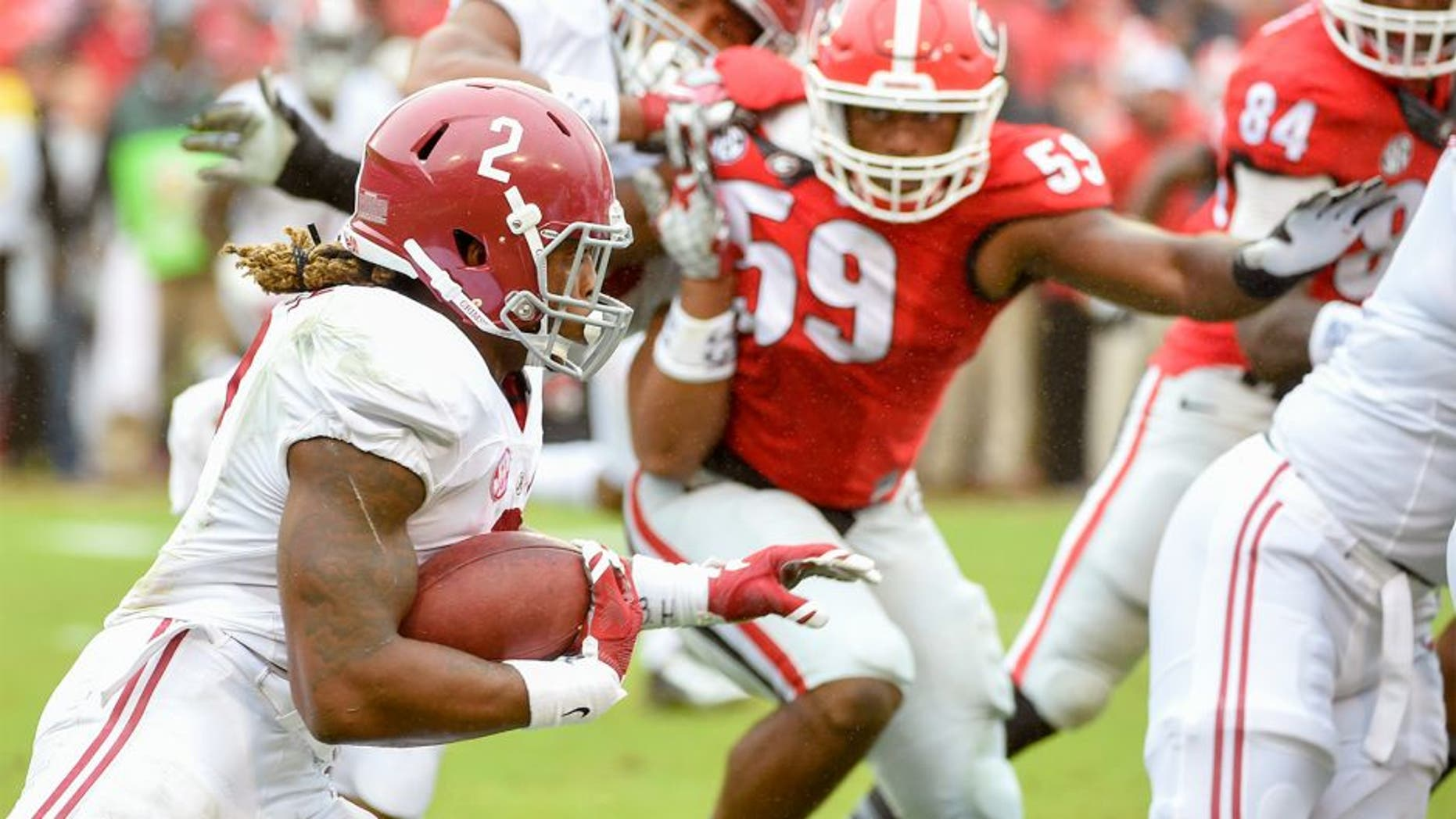 Oct 3, 2015; Athens, GA, USA; Alabama Crimson Tide running back Derrick Henry (2) runs the ball during the first quarter Georgia Bulldogs at Sanford Stadium. Mandatory Credit: John David Mercer-USA TODAY Sports