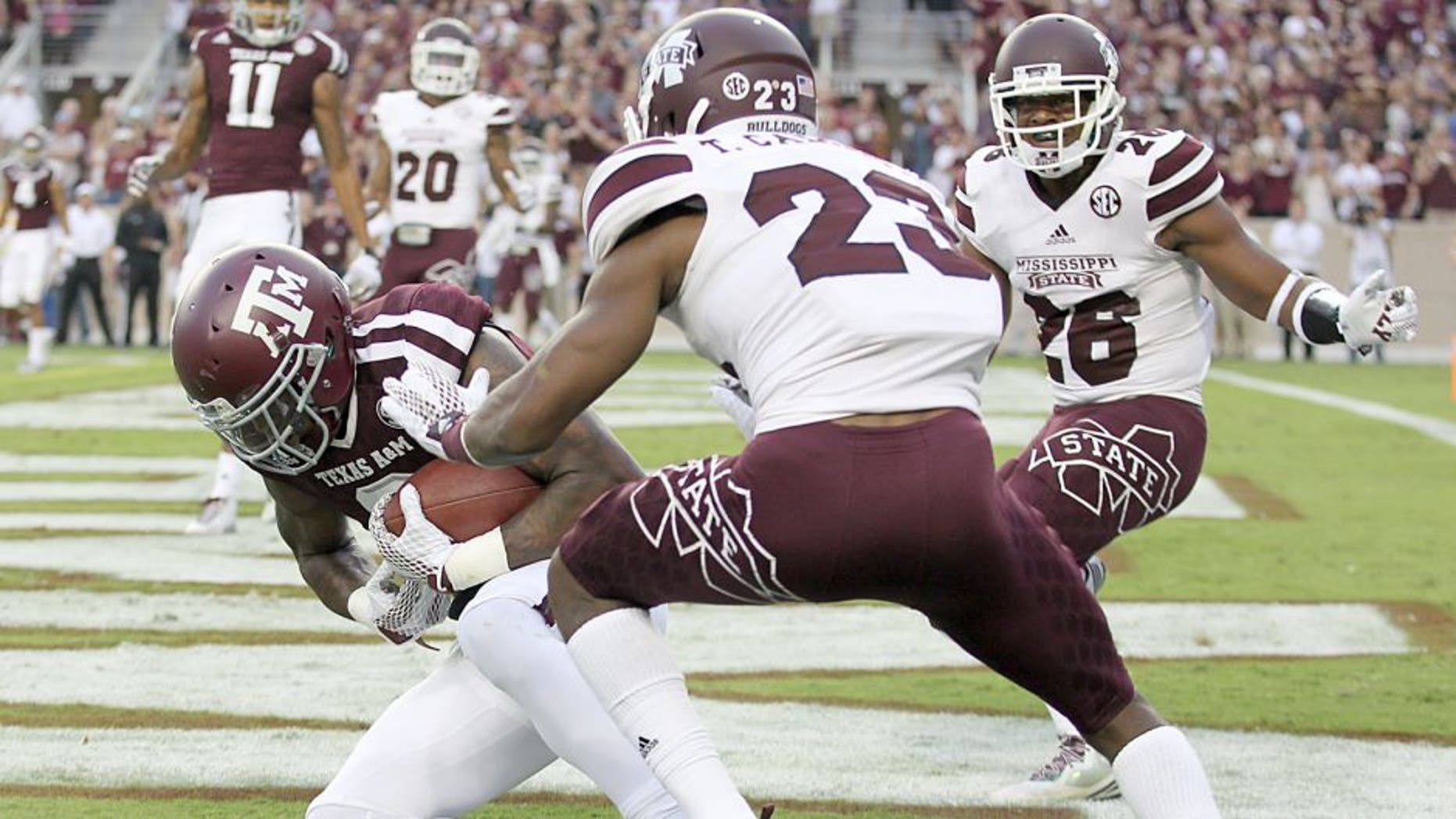 COLLEGE STATION, TX - OCTOBER 03: Ricky Seals-Jones #9 of the Texas A&M Aggies catches a touchdown pass while being defended by Taveze Calhoun #23 of the Mississippi State Bulldogs in the first quarter on October 3, 2015 at Kyle Field in College Station, Texas. (Photo by Thomas B. Shea/Getty Images)