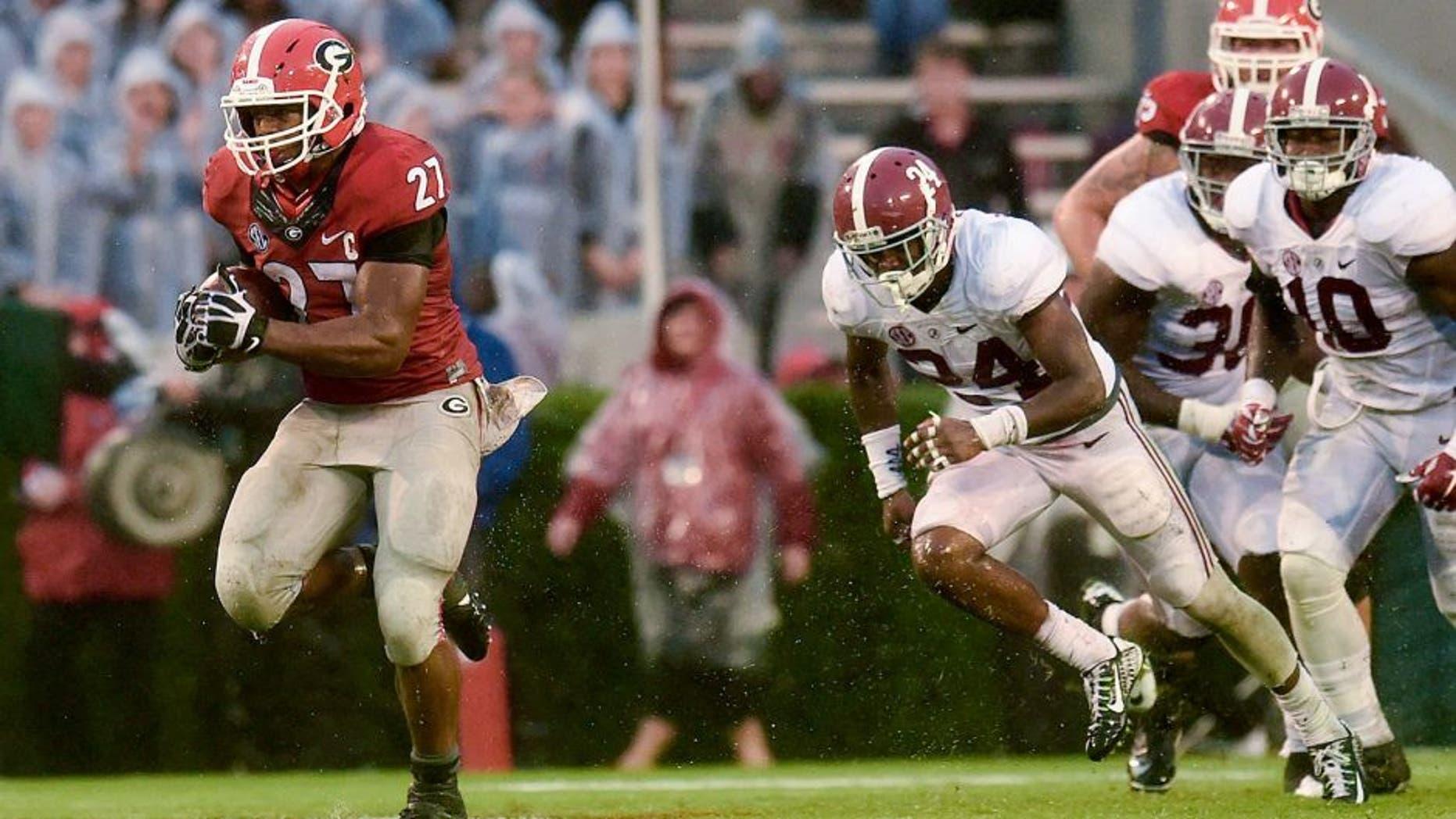 Oct 3, 2015; Athens, GA, USA; Georgia Bulldogs running back Nick Chubb (27) runs the ball past Alabama Crimson Tide defensive back Geno Matias-Smith (24) for a touchdown during the third quarter at Sanford Stadium. Mandatory Credit: Dale Zanine-USA TODAY Sports