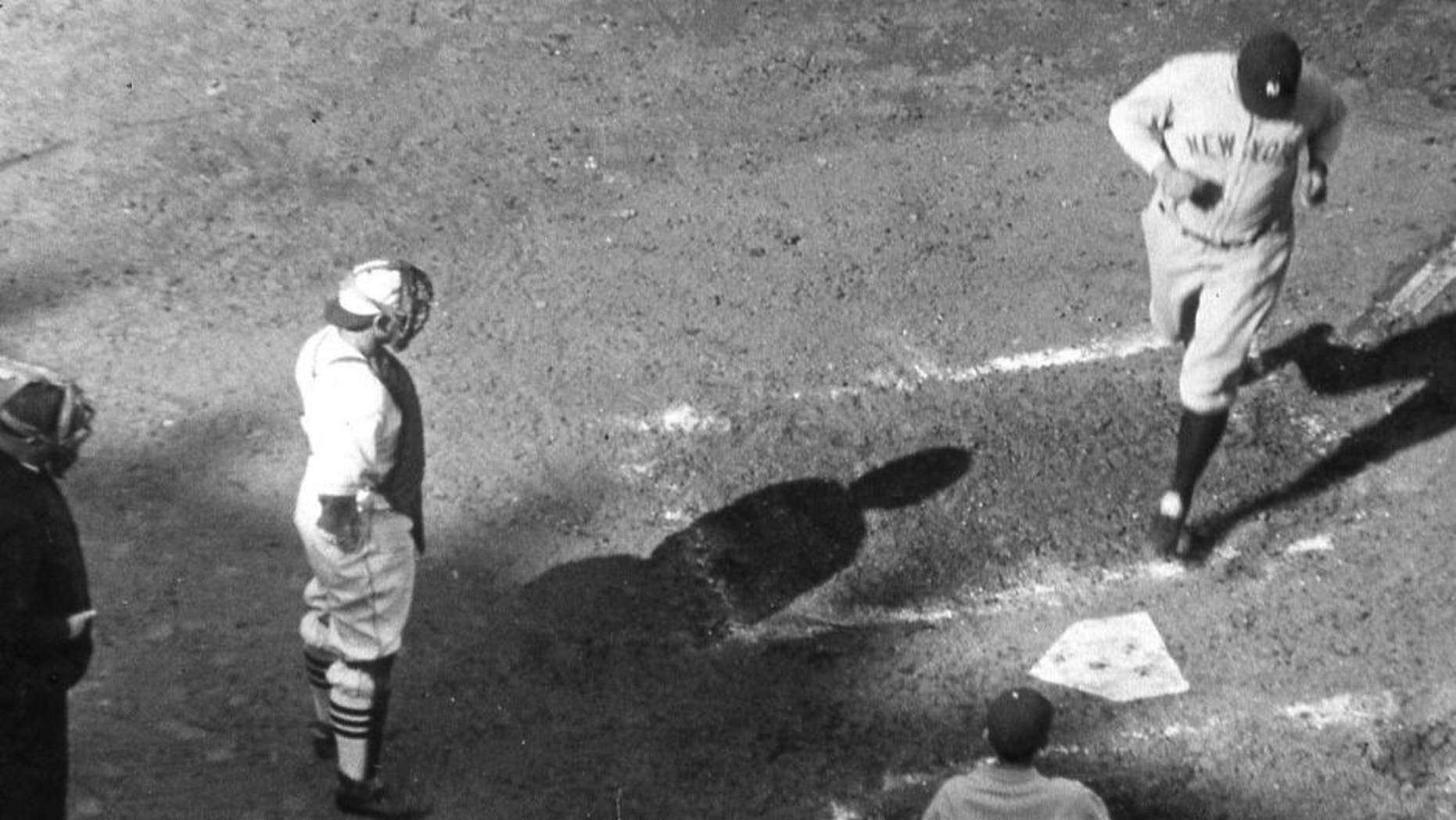 NEW YORK - October 6, 1926. Babe Ruth is crossing the plate after hitting his third home run on October 11, 1926 in the fourth game of the World Series in St. Louis. Bob O'Farrell is the Cardinals catcher. (Photo by Mark Rucker/Transcendental Graphics, Getty Images) *** Local Caption *** Babe Ruth;Bob O'Farrell
