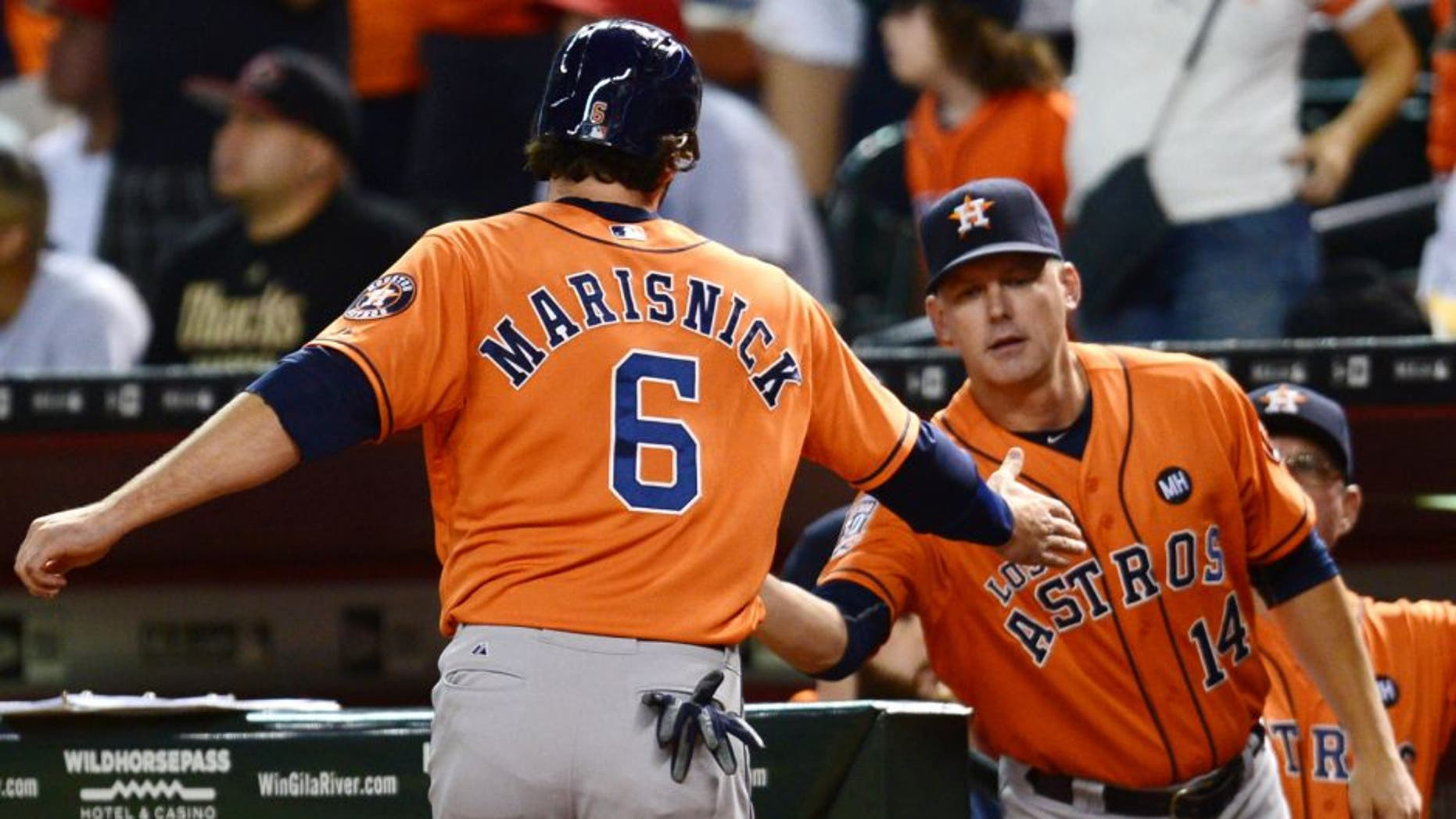Oct 3, 2015; Phoenix, AZ, USA; Houston Astros center fielder Jake Marisnick (6) slaps hands with Houston Astros manager A.J. Hinch (14) after scoring a run in the seventh inning against the Arizona Diamondbacks at Chase Field. Mandatory Credit: Joe Camporeale-USA TODAY Sports