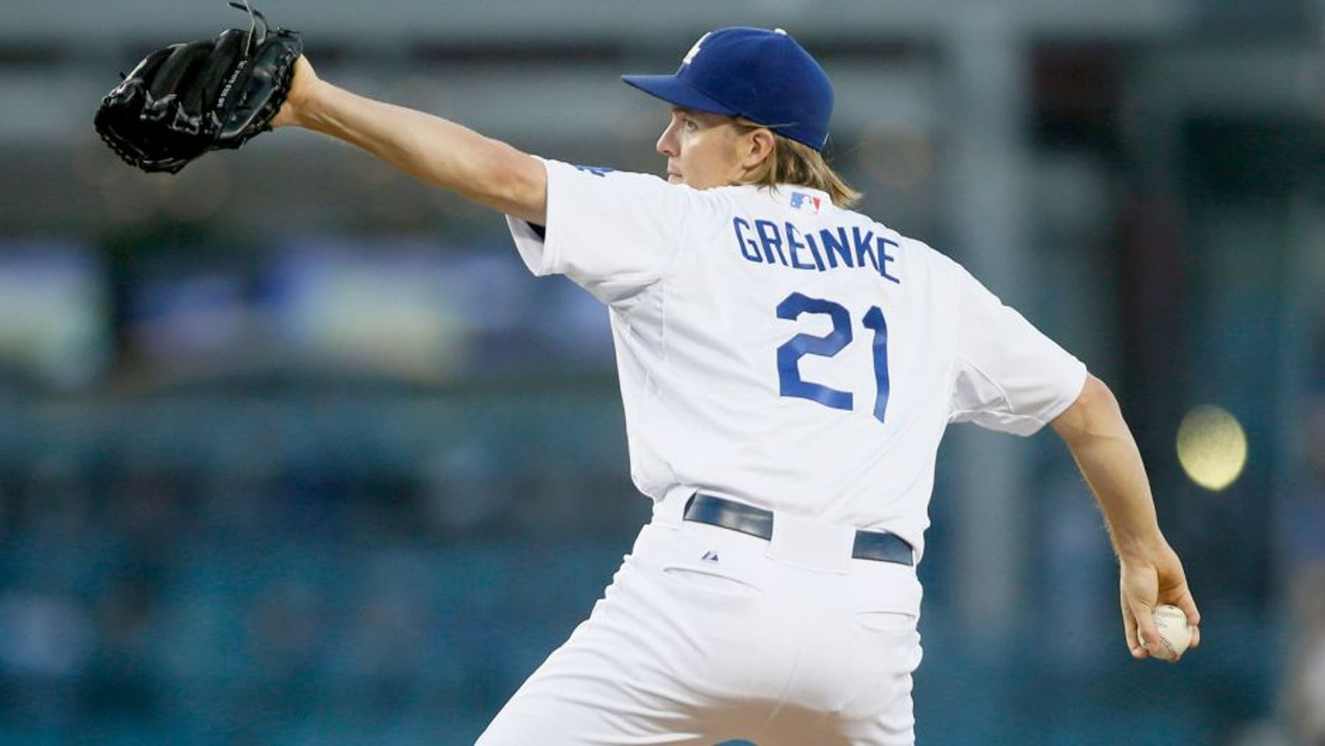 Los Angeles Dodgers starting pitcher Zack Greinke delivers against the San Diego Padres during the second inning of a baseball game Saturday, Oct. 3, 2015, in Los Angeles. (AP Photo/Danny Moloshok)