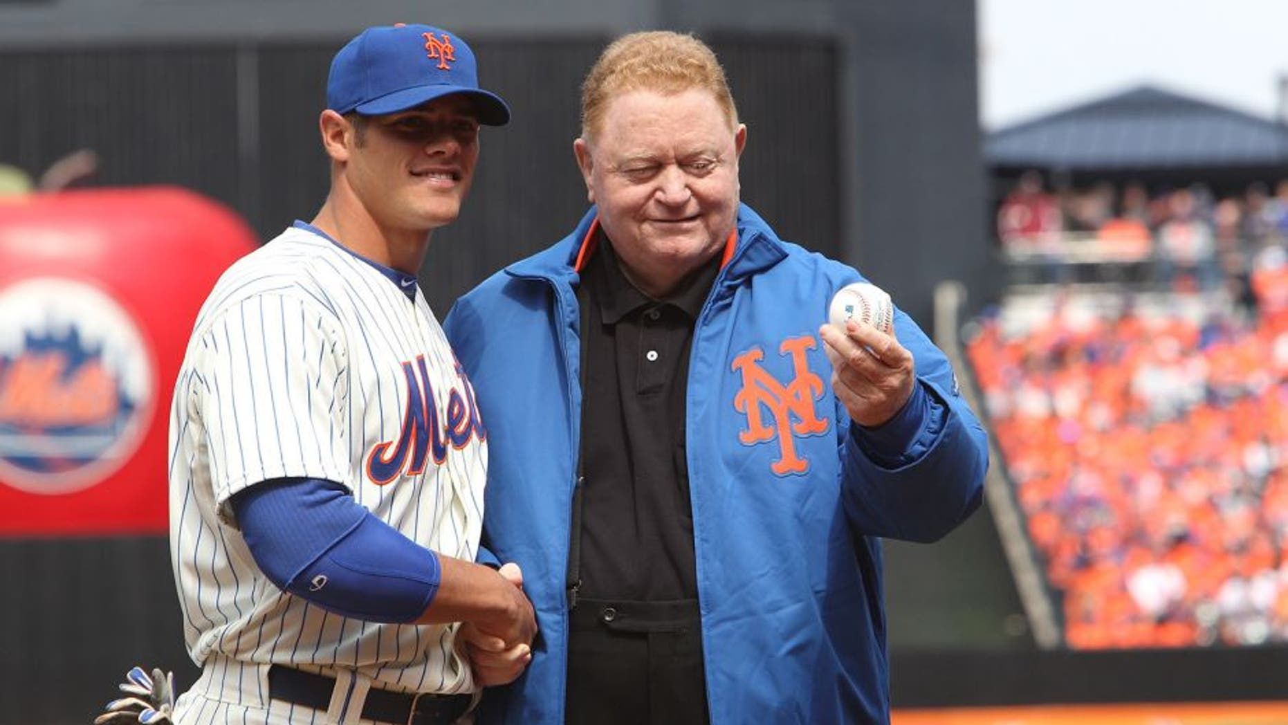 NEW YORK, NY - APRIL 01: Former New York Mets player Rusty Staub throws out the first pitch to Catcher Anthony Recker #20 of the New York Mets before the game against the San Diego Padres on Opening Day at Citi Field on April 1, 2013 in New York City. Mets beat the Padres, 11-2. (Photo by Al Pereira/Getty Images)