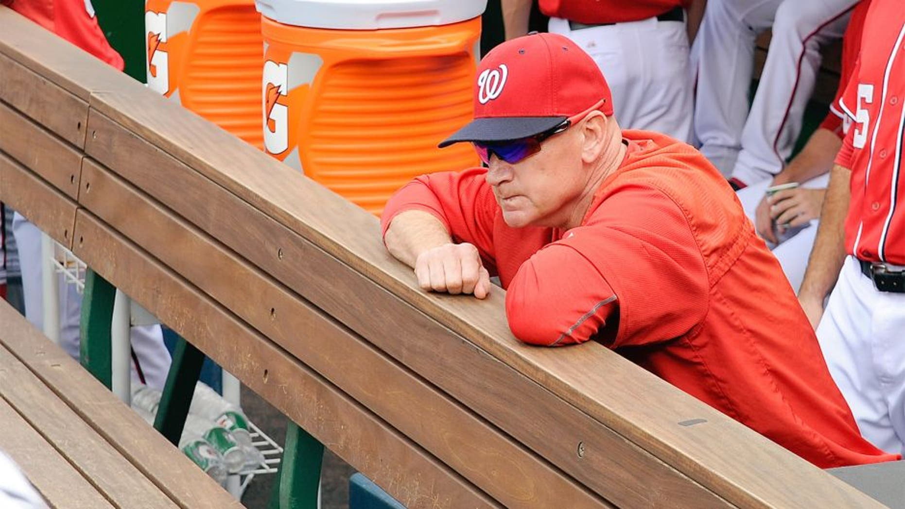 WASHINGTON, DC - SEPTEMBER 28: Manager Matt Williams #9 of the Washington Nationals looks out of the dugout before the game against the Cincinnati Reds at Nationals Park on September 28, 2015 in Washington, DC. (Photo by Greg Fiume/Getty Images)
