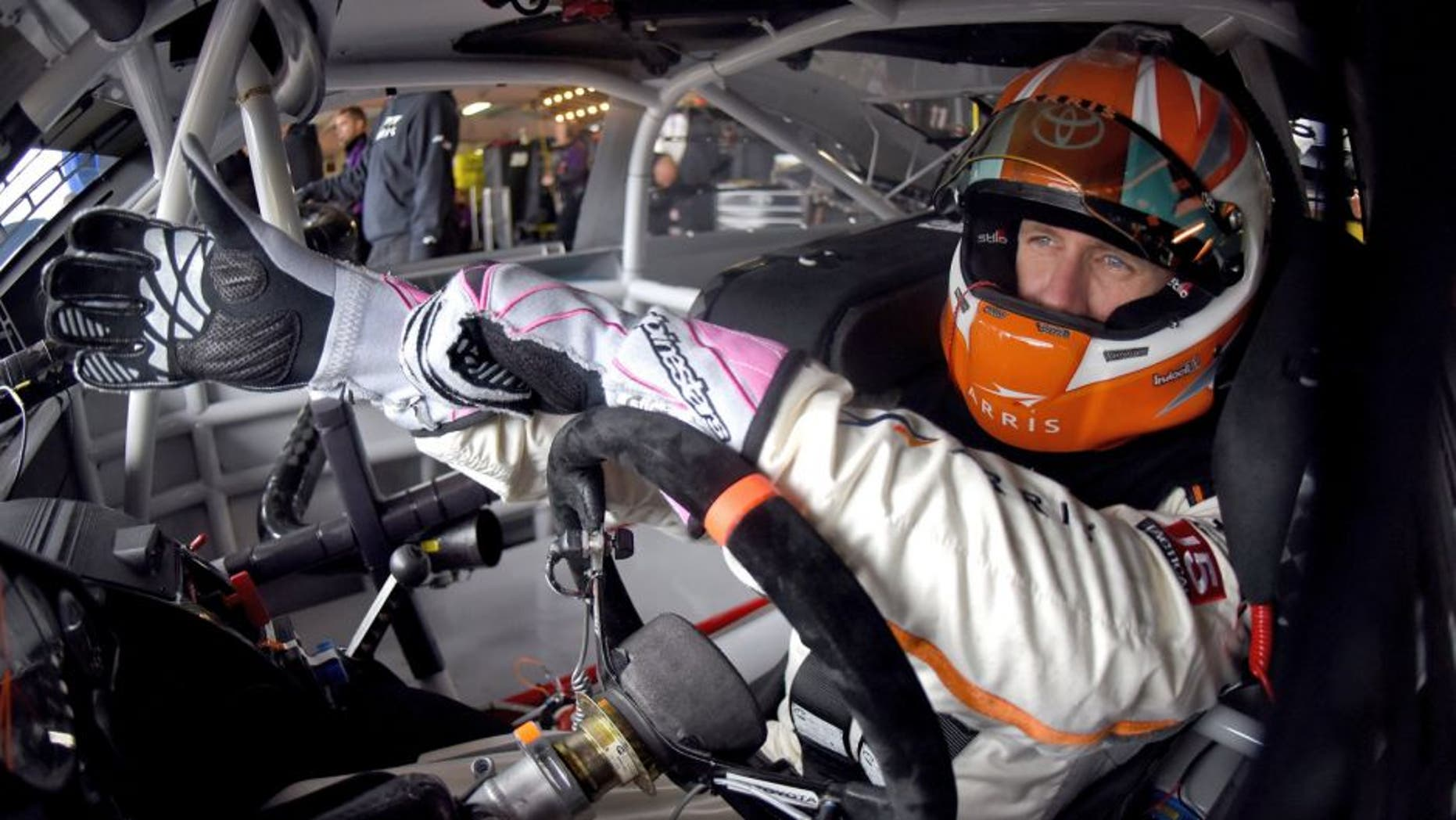 DOVER, DE - OCTOBER 03: Carl Edwards, driver of the #19 ARRIS Toyota, sits in his car in the garage area during practice for the NASCAR Sprint Cup Series AAA 400 at Dover International Speedway on October 3, 2015 in Dover, Delaware. (Photo by Jonathan Moore/Getty Images)