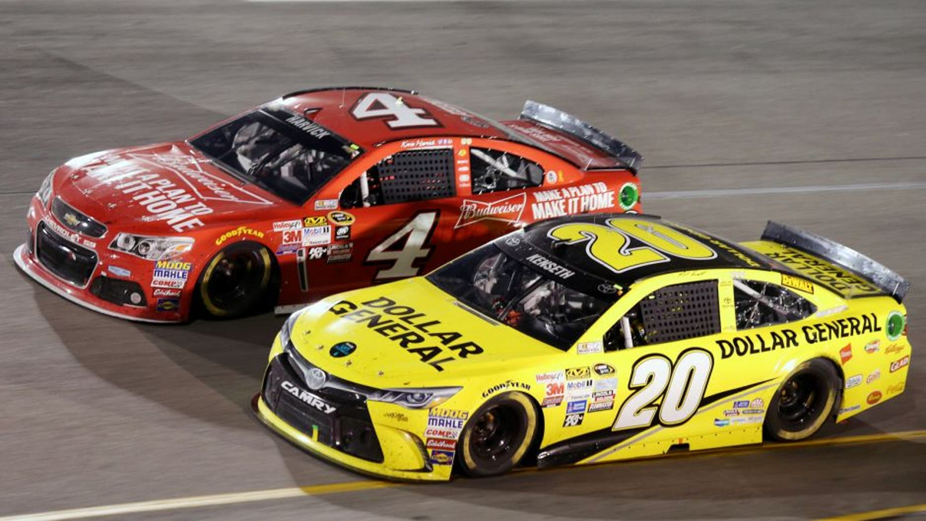 Matt Kenseth, driver of the #20 Dollar General Toyota, races Kevin Harvick, driver of the #4 Budweiser/Jimmy John's Chevrolet, during the NASCAR Sprint Cup Series Federated Auto Parts 400 at Richmond International Raceway on September 12, 2015 in Richmond, Virginia. (Photo by Jerry Markland/Getty Images)