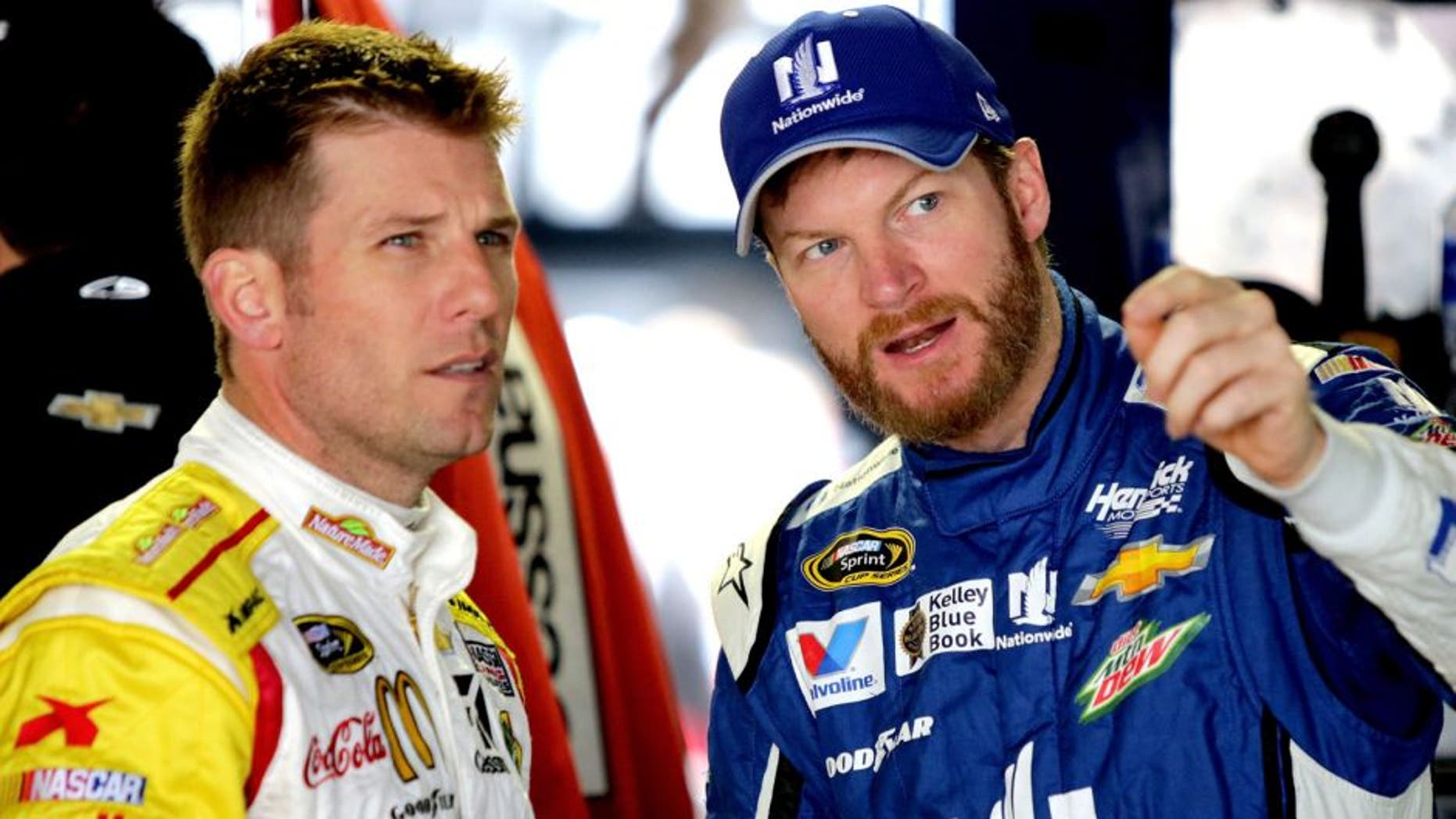 DOVER, DE - OCTOBER 03: (L-R) Jamie McMurray, driver of the #1 Nature Made Chevrolet, talks to Dale Earnrhardt Jr., driver of the #88 Nationwide Plenti Chevrolet, during practice for the NASCAR Sprint Cup Series AAA 400 at Dover International Speedway on October 3, 2015 in Dover, Delaware. (Photo by Jerry Markland/Getty Images)