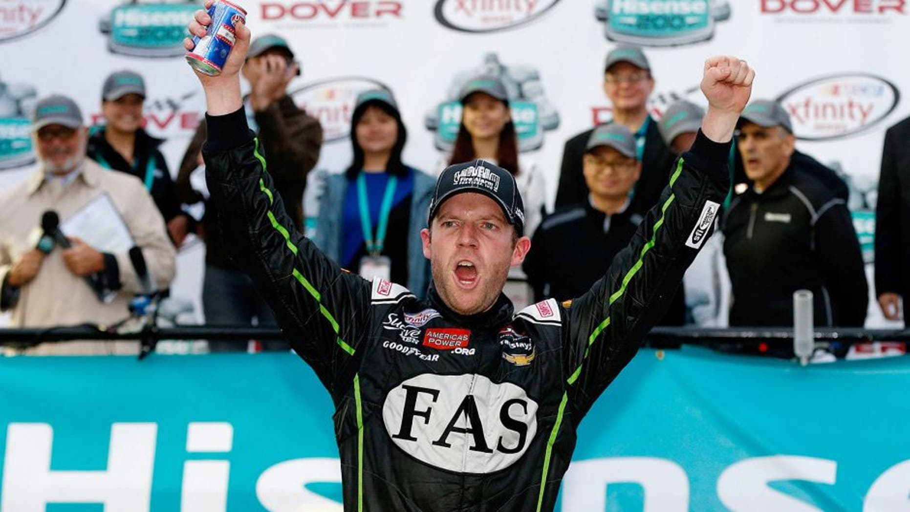DOVER, DE - OCTOBER 03: Regan Smith, driver of the #7 Fire Alarm Services Chevrolet, celebrates in Victory LanVictory Laneafter winning the NASCAR XFINITY Series Hisense 200 at Dover International Speedway on October 3, 2015 in Dover, Delaware. (Photo by Brian Lawdermilk/Getty Images)