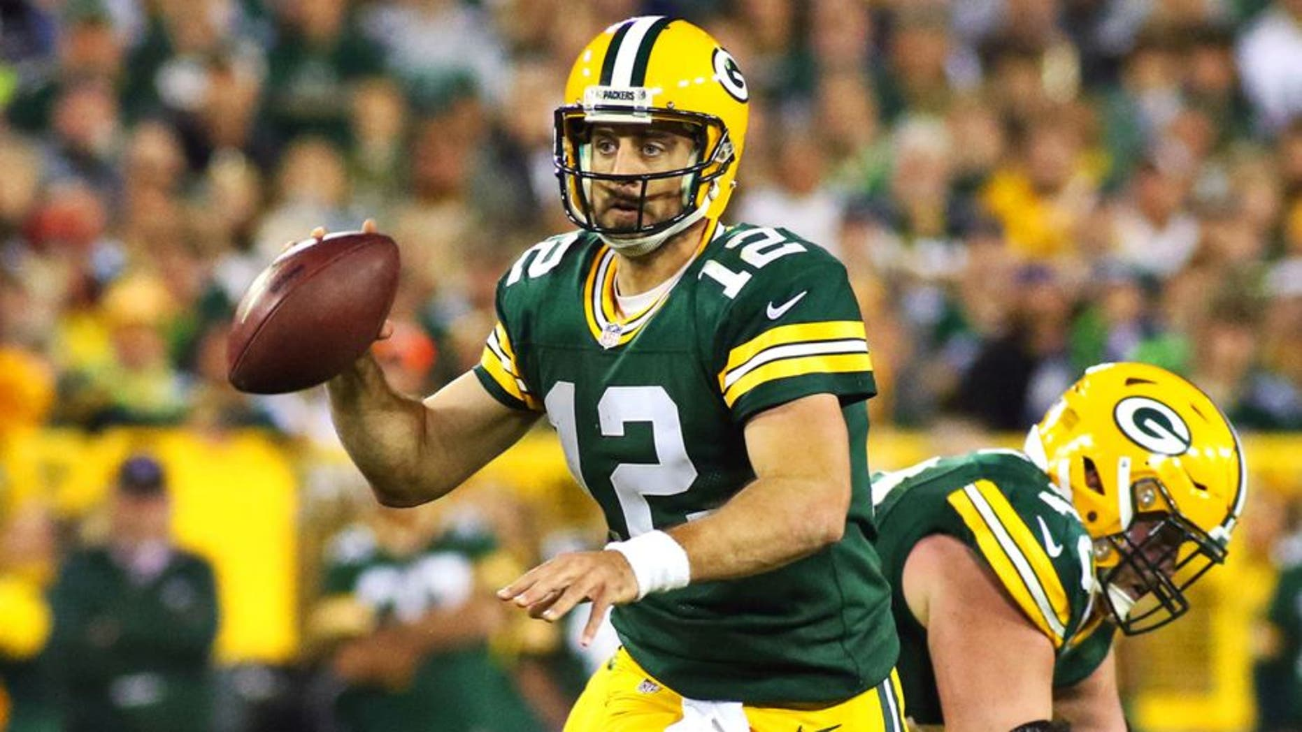 Sep 20, 2015; Green Bay, WI, USA; Green Bay Packers quarterback Aaron Rodgers (12) against the Seattle Seahawks during the second half at Lambeau Field. Packers won 27-17. Mandatory Credit: Ray Carlin-USA TODAY Sports