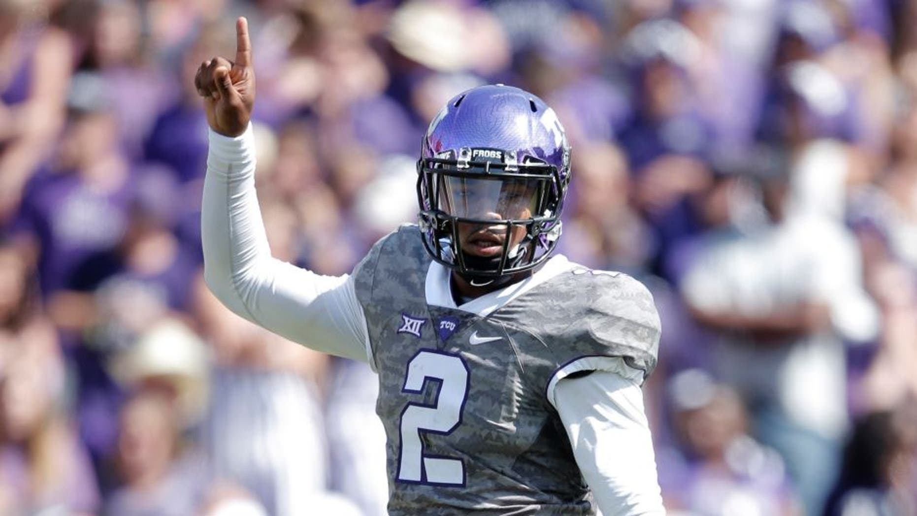 Oct 3, 2015; Fort Worth, TX, USA; Texas Christian University Horned Frogs quarterback Trevone Boykin (2) celebrates a first down against the University of Texas Longhorns in the third quarter at Amon G. Carter Stadium. Mandatory Credit: Erich Schlegel-USA TODAY Sports