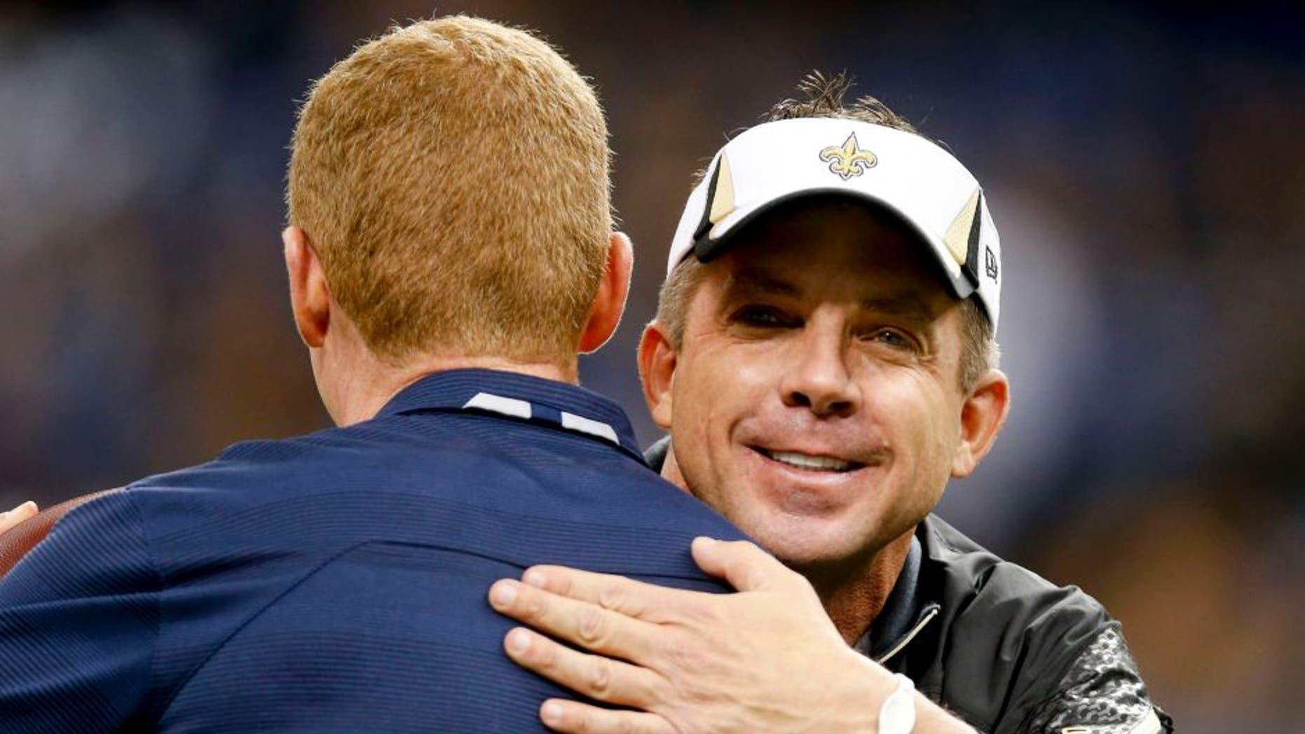 Nov 10, 2013; New Orleans, LA, USA; New Orleans Saints head coach Sean Payton greets Dallas Cowboys head coach Jason Garrett prior to a game at Mercedes-Benz Superdome. Mandatory Credit: Derick E. Hingle-USA TODAY Sports