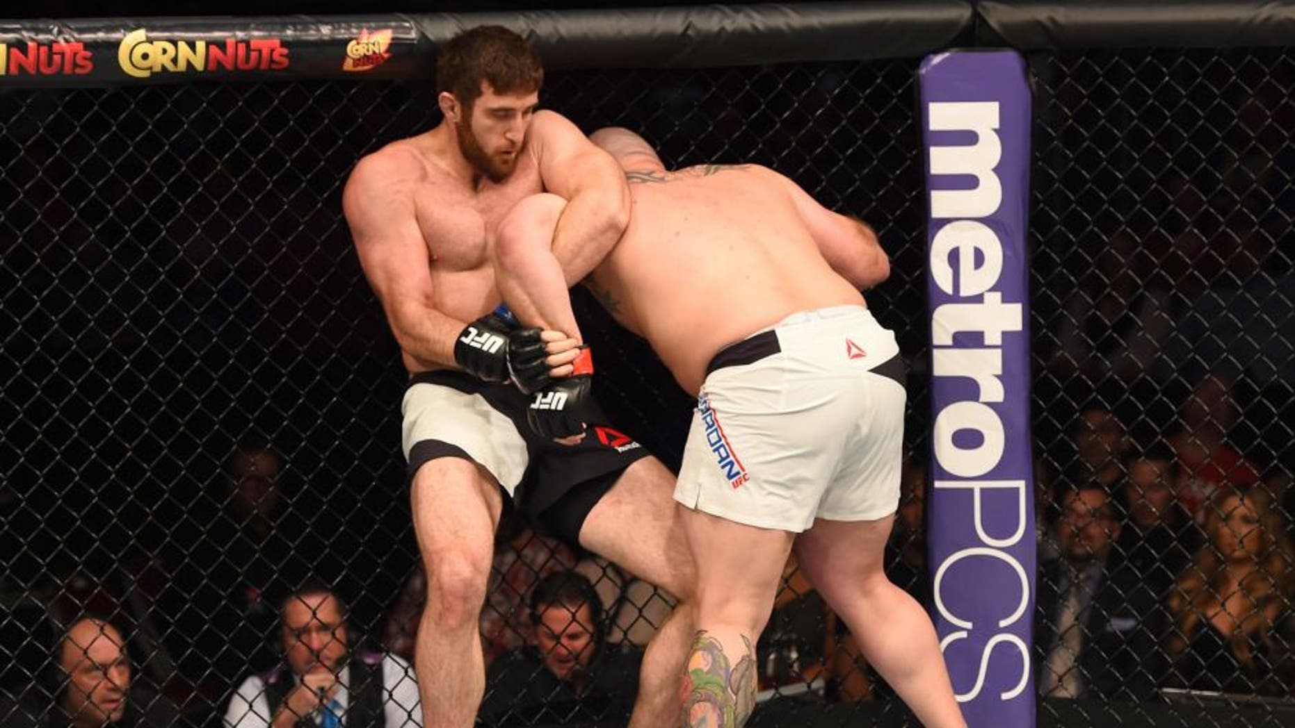 HOUSTON, TX - OCTOBER 03: (L-R) Ruslan Magomedov attempts to submit Shawn Jordan in their heavyweight bout during the UFC 192 event at the Toyota Center on October 3, 2015 in Houston, Texas. (Photo by Josh Hedges/Zuffa LLC/Zuffa LLC via Getty Images)