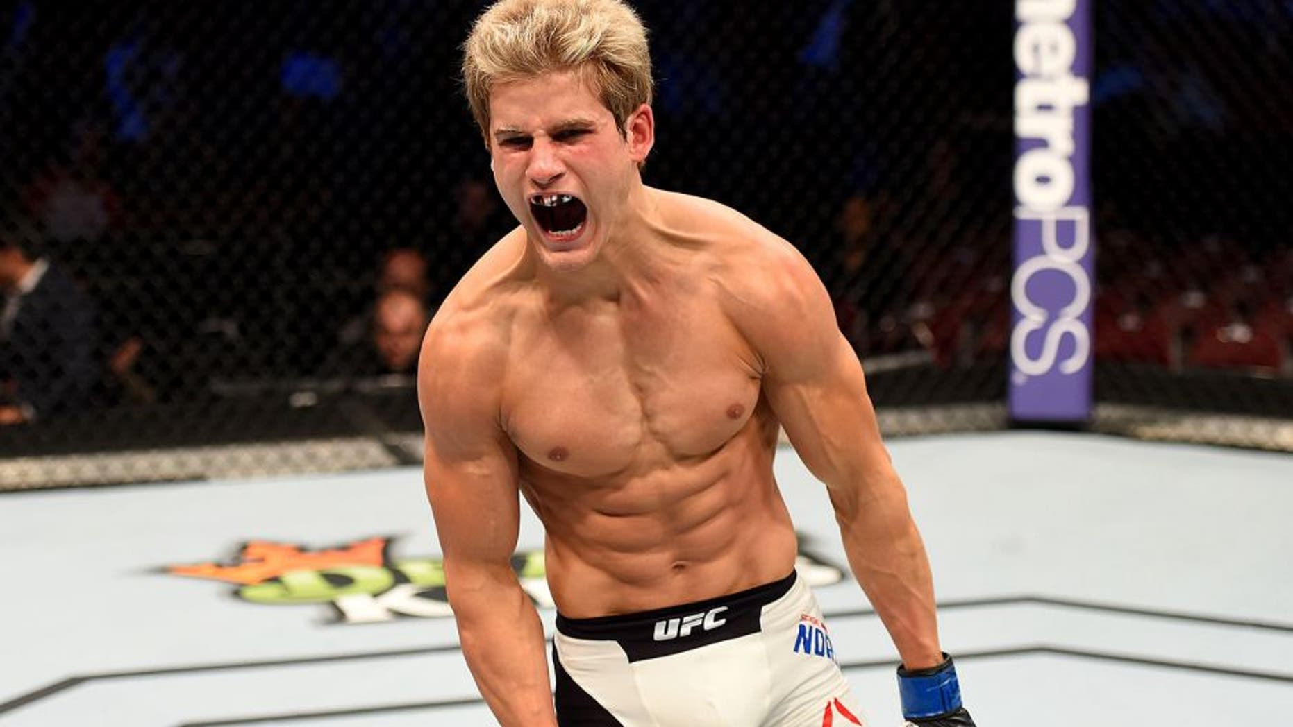 HOUSTON, TX - OCTOBER 03: Sage Northcutt celebrates his victory over Francisco Trevino in their lightweight bout during the UFC 192 event at the Toyota Center on October 3, 2015 in Houston, Texas. (Photo by Josh Hedges/Zuffa LLC/Zuffa LLC via Getty Images)