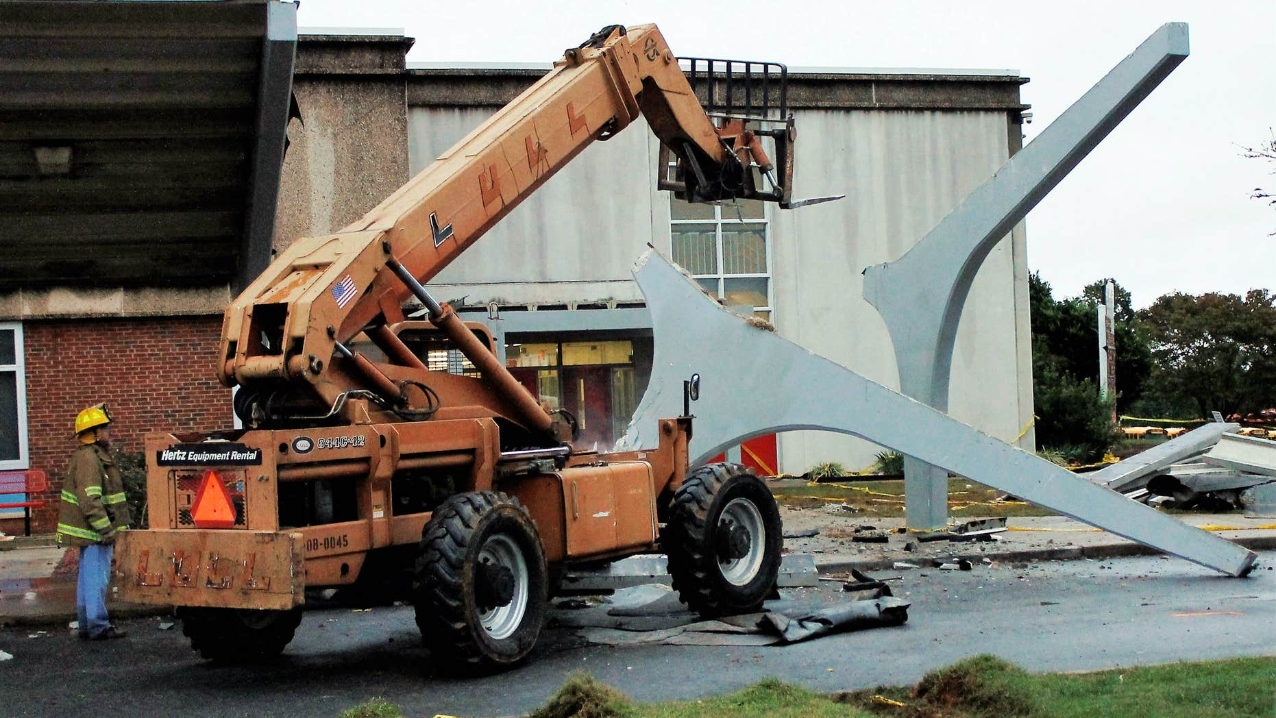 Oct. 3, 2015: he remains of a concrete canopy that collapsed sit in front of North Iredell High School in Olin, N.C.