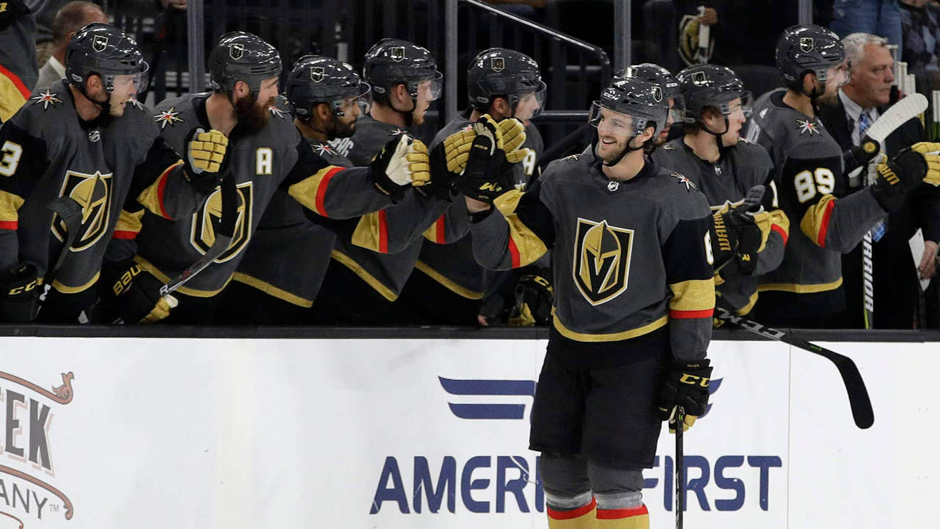 Vegas Golden Knights' Colin Miller celebrates after scoring against the Colorado Avalanche during the second period of an NHL preseason hockey game Thursday, Sept. 28, 2017, in Las Vegas.