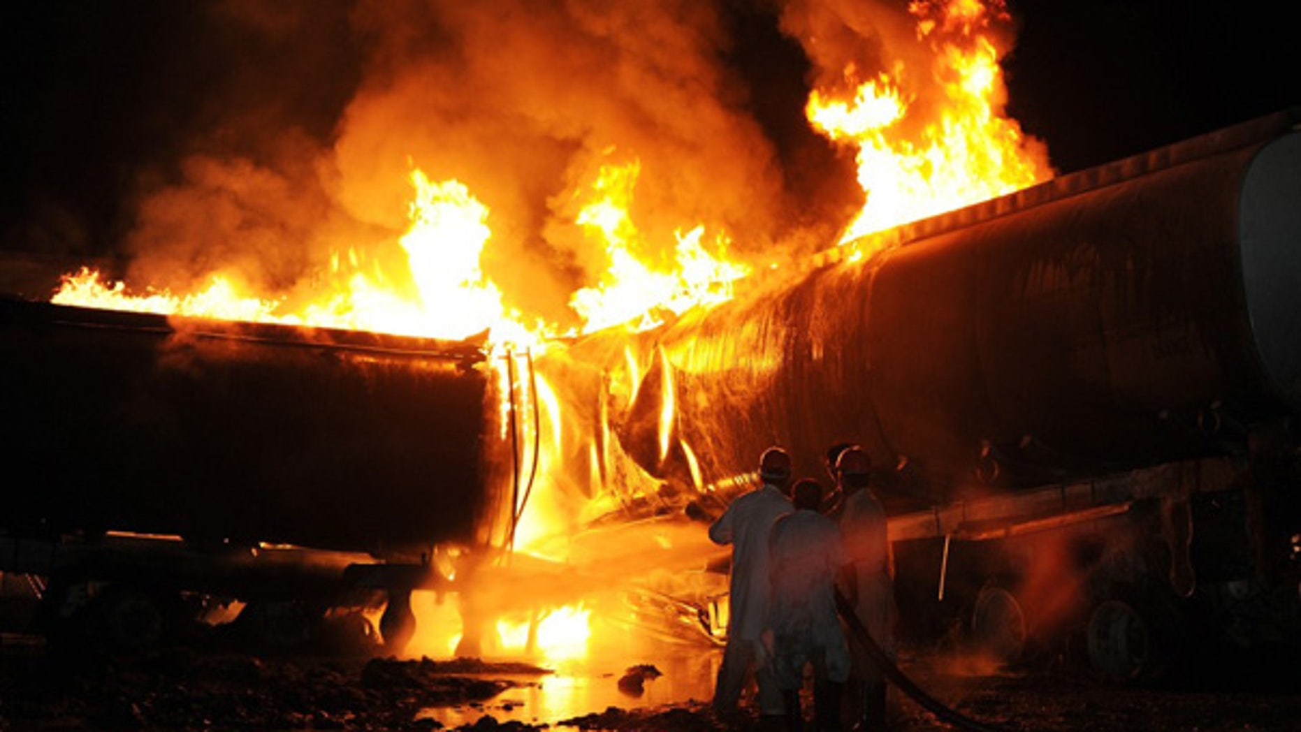 Oct. 4: Pakistani firefighters try to extinguish burning NATO supplies and oil tankers outside of Islamabad.