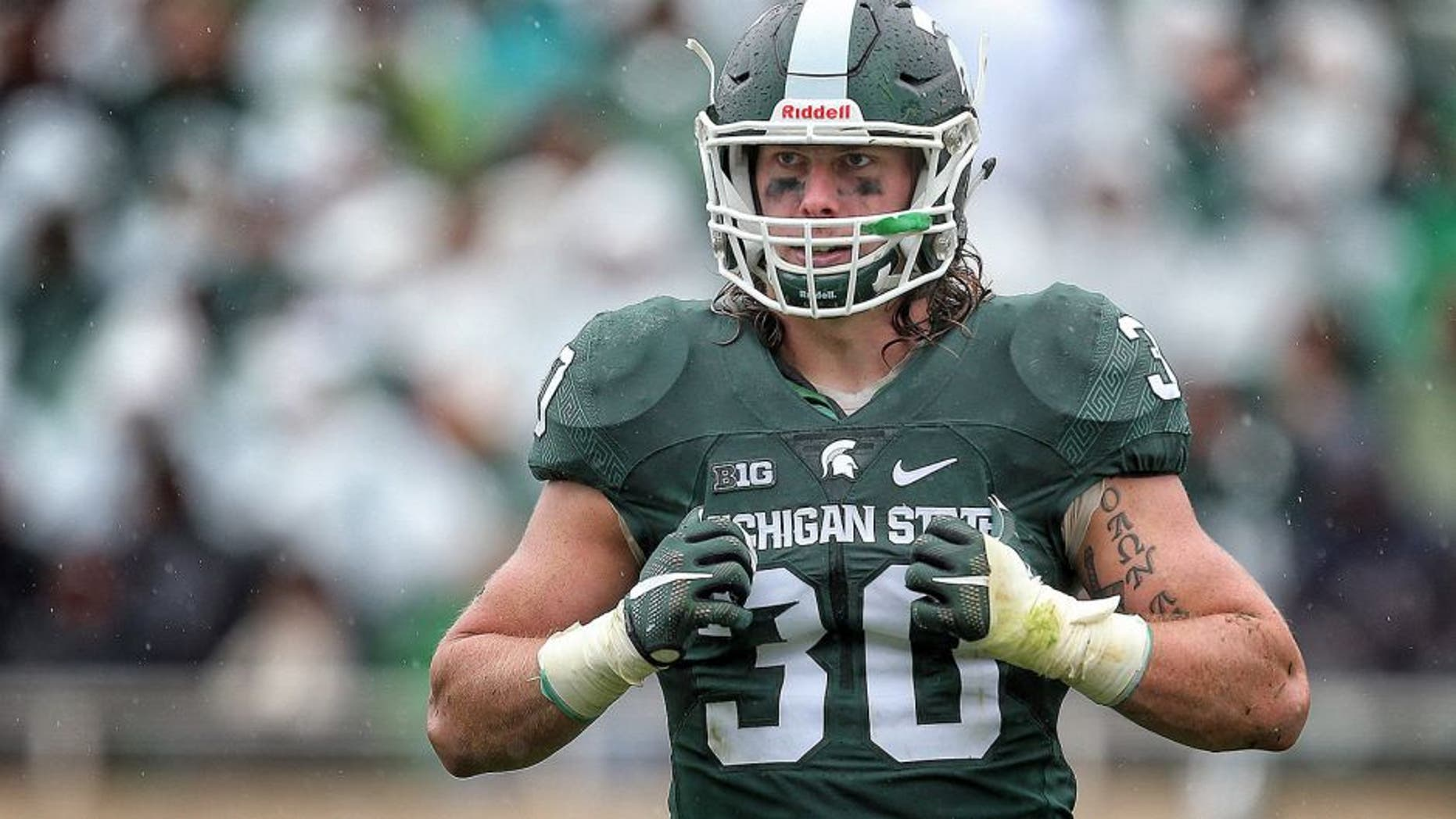 Oct 3, 2015; East Lansing, MI, USA; Michigan State Spartans linebacker Riley Bullough (30) looks to the sidelines during the 2nd half of a game against the Purdue Boilermakers at Spartan Stadium. MSU won 24-21. Mandatory Credit: Mike Carter-USA TODAY Sports