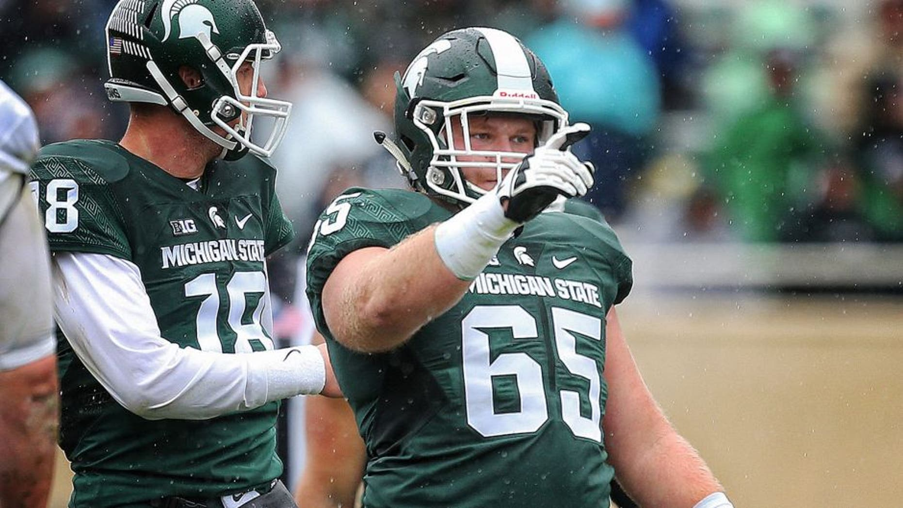Oct 3, 2015; East Lansing, MI, USA; Michigan State Spartans offensive lineman Brian Allen (65) points out coverage before the snap of the ball during the 2nd half of a game at Spartan Stadium. MSU won 24-21. Mandatory Credit: Mike Carter-USA TODAY Sports