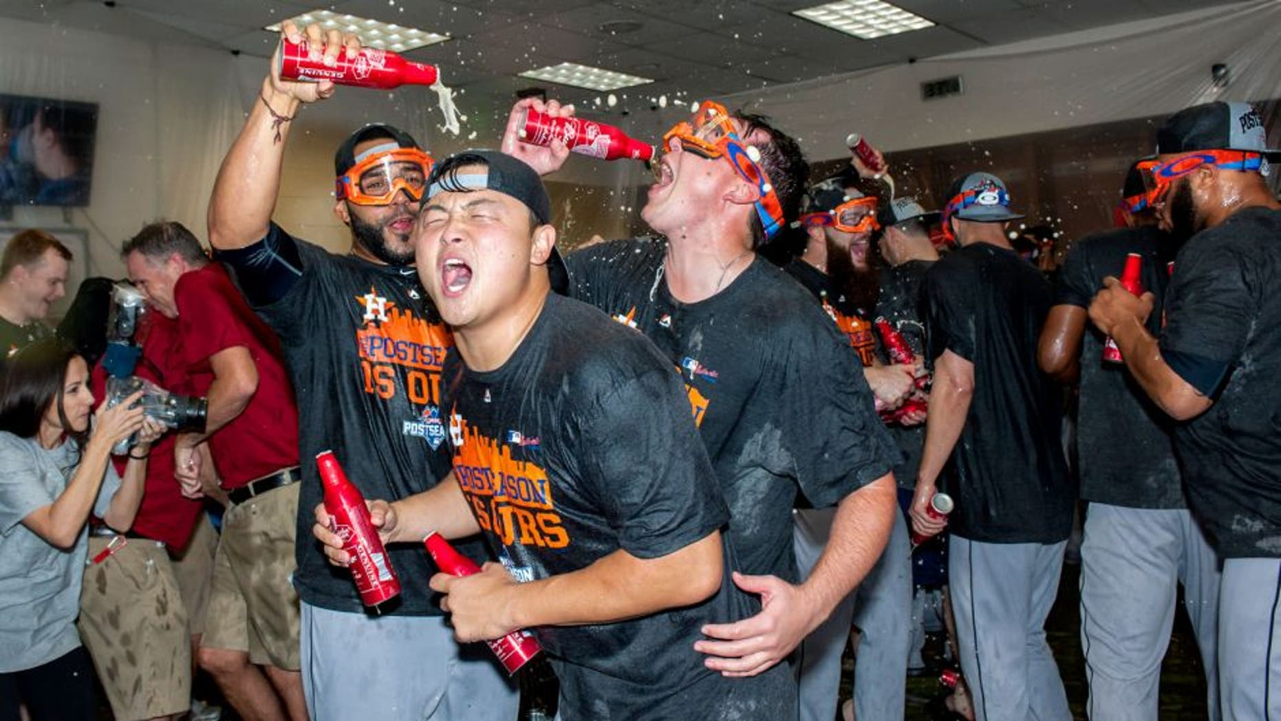 PHOENIX, AZ - OCTOBER 4: Hank Conger #16 of the Houston Astros celebrates with his team after clinching an American League wild card spot after a MLB game against the Arizona Diamondbacks on October 4, 2015 at Chase Field in Phoenix, Arizona. (Photo by Darin Wallentine/Getty Images)