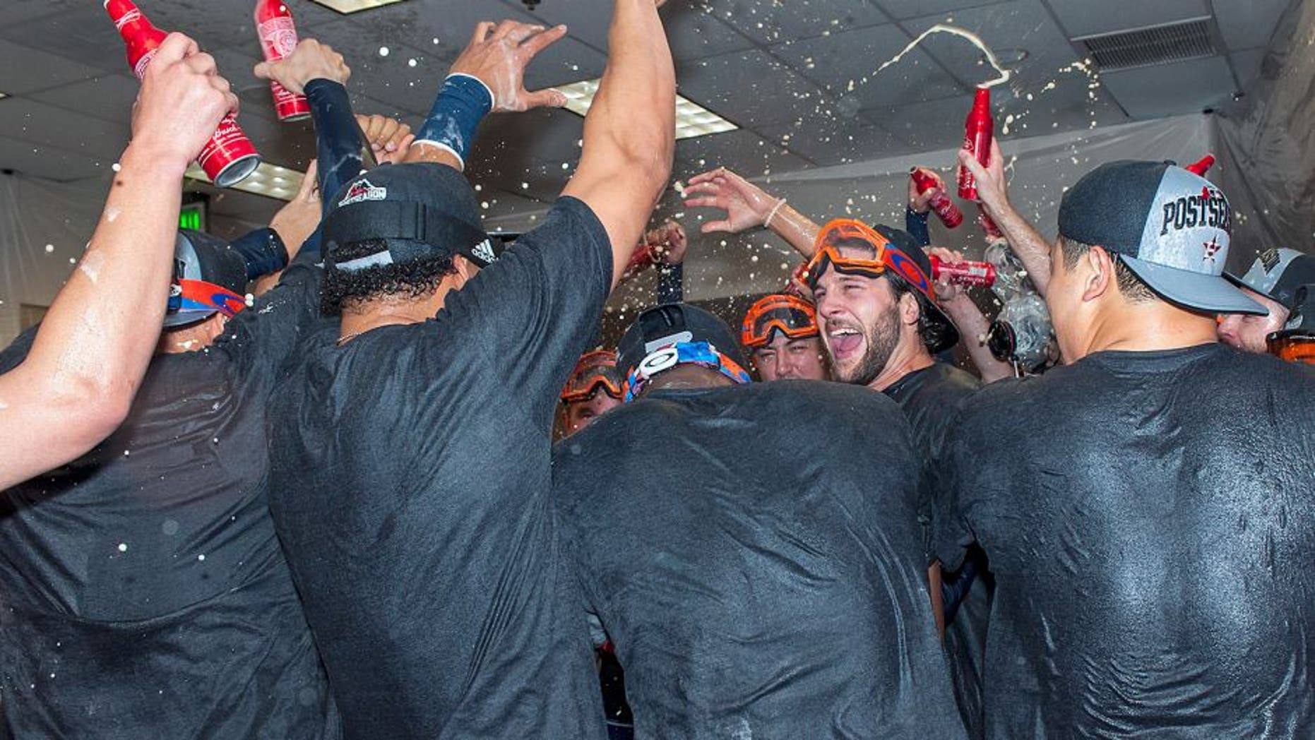 PHOENIX, AZ - OCTOBER 4: Jake Marisnick #6 of the Houston Astros celebrates with his team after clinching a wild card position in the American League playoffs after a MLB game against the Arizona Diamondbacks on October 4, 2015 at Chase Field in Phoenix, Arizona. (Photo by Darin Wallentine/Getty Images)