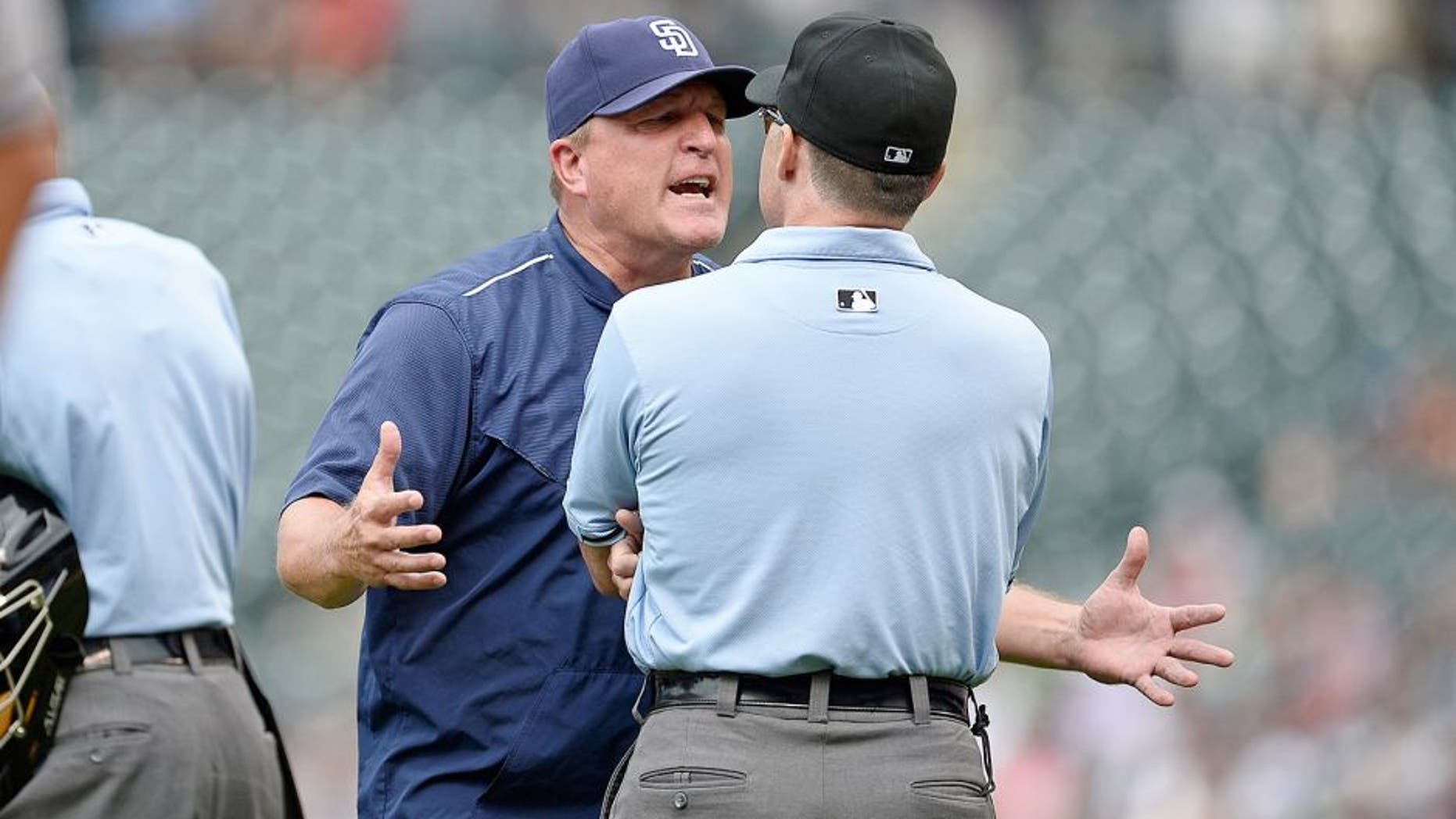 Aug 16, 2015; Denver, CO, USA; San Diego Padres interim manager Pat Murphy (24) argues with third base umpire Dan Iassogna (58) following a replay call in the seventh inning against the Colorado Rockies at Coors Field. The Rockies defeated the Padres 5-0. Mandatory Credit: Ron Chenoy-USA TODAY Sports