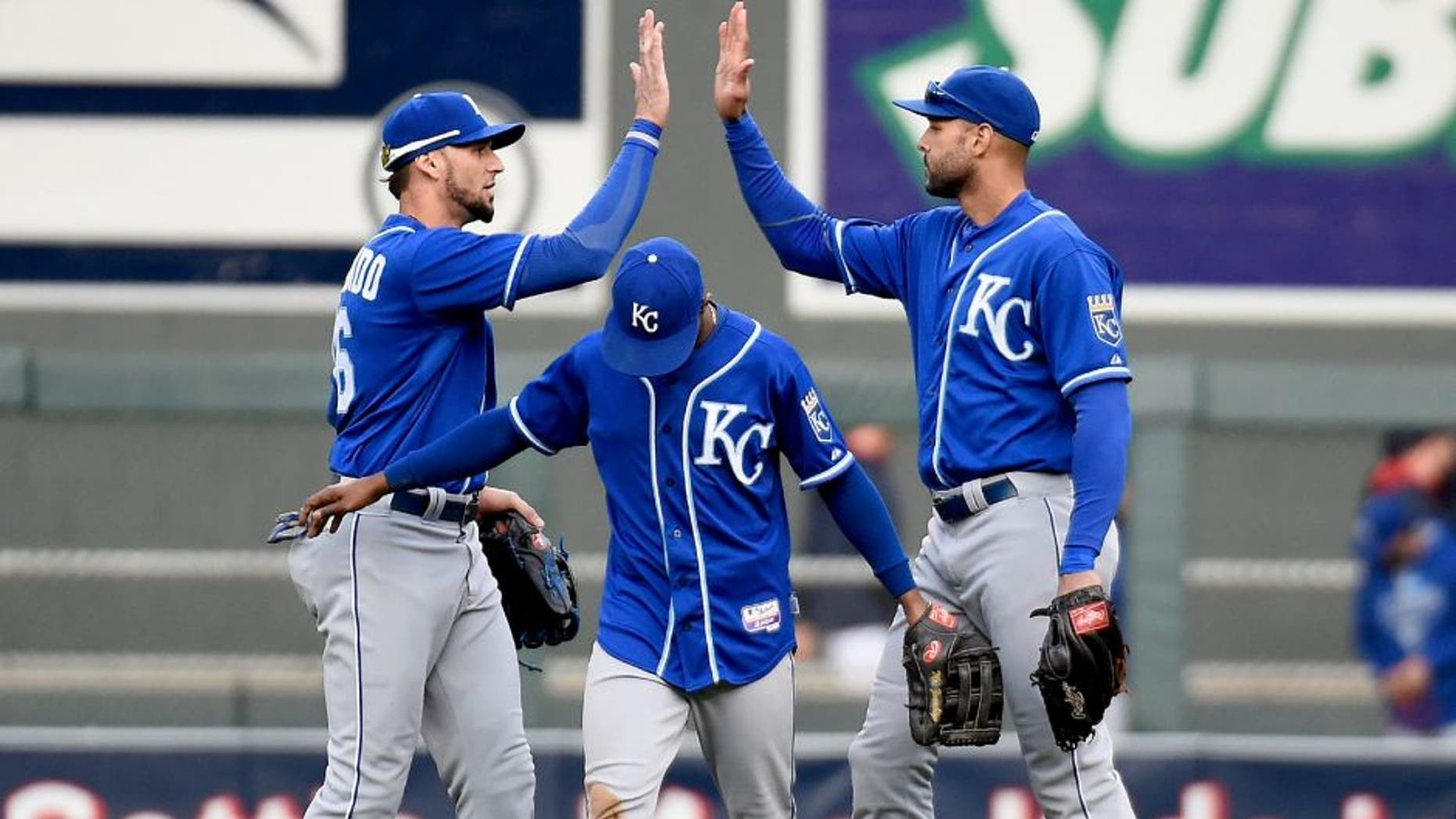 MINNEAPOLIS, MN - OCTOBER 4: (L-R) Paulo Orlando #16, Jarrod Dyson #1 and Alex Rios #15 of the Kansas City Royals celebrate a win of the game against the Minnesota Twins on October 4, 2015 at Target Field in Minneapolis, Minnesota. The Royals defeated the Twins 6-1. (Photo by Hannah Foslien/Getty Images)