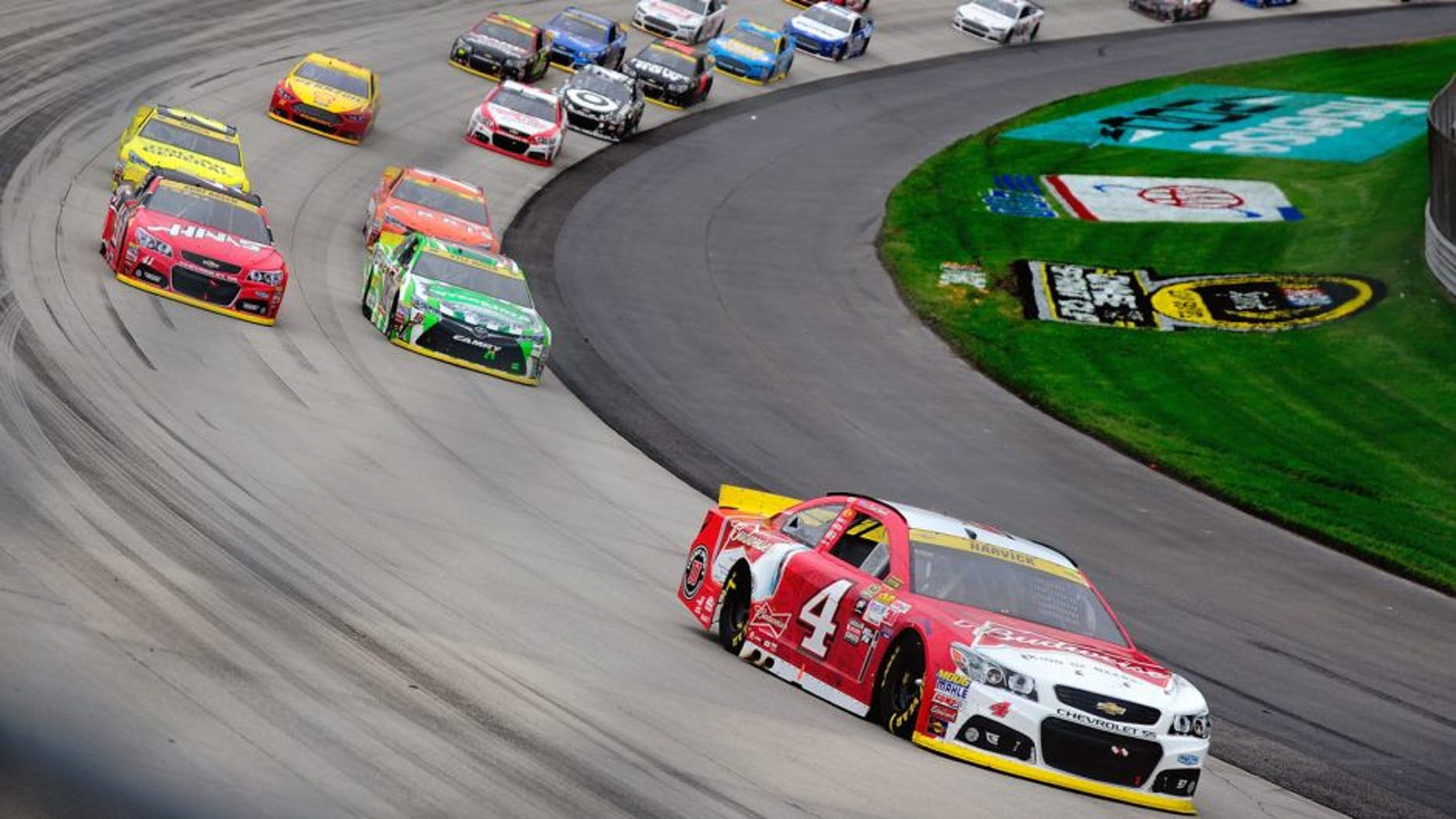 Kevin Harvick, driver of the #4 Budweiser/Jimmy John's Chevrolet, leads a pack of cars during the NASCAR Sprint Cup Series AAA 400 at Dover International Speedway on October 4, 2015 in Dover, Delaware. (Photo by Jeff Curry/Getty Images)