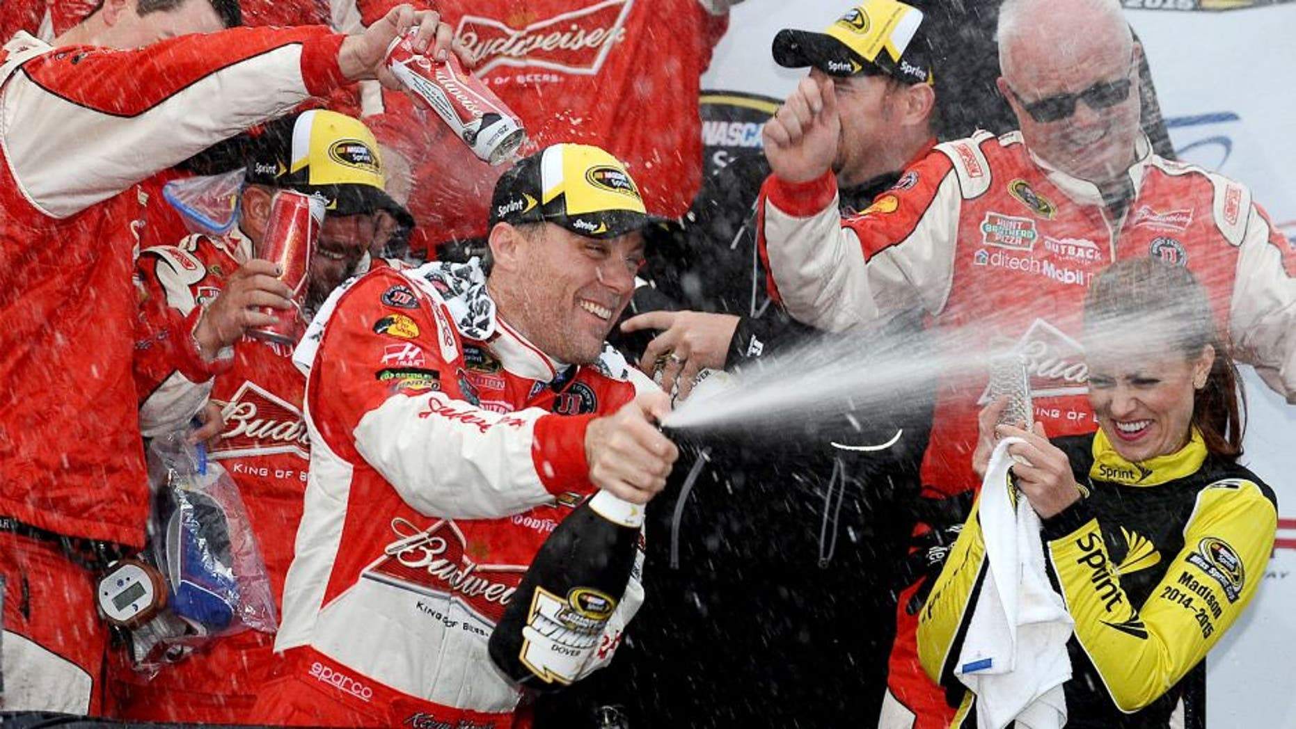 DOVER, DE - OCTOBER 04: Kevin Harvick, driver of the #4 Budweiser/Jimmy John's Chevrolet, celebrates in victory lane after winning the NASCAR Sprint Cup Series AAA 400 at Dover International Speedway on October 4, 2015 in Dover, Delaware. (Photo by Rainier Ehrhardt/NASCAR via Getty Images)