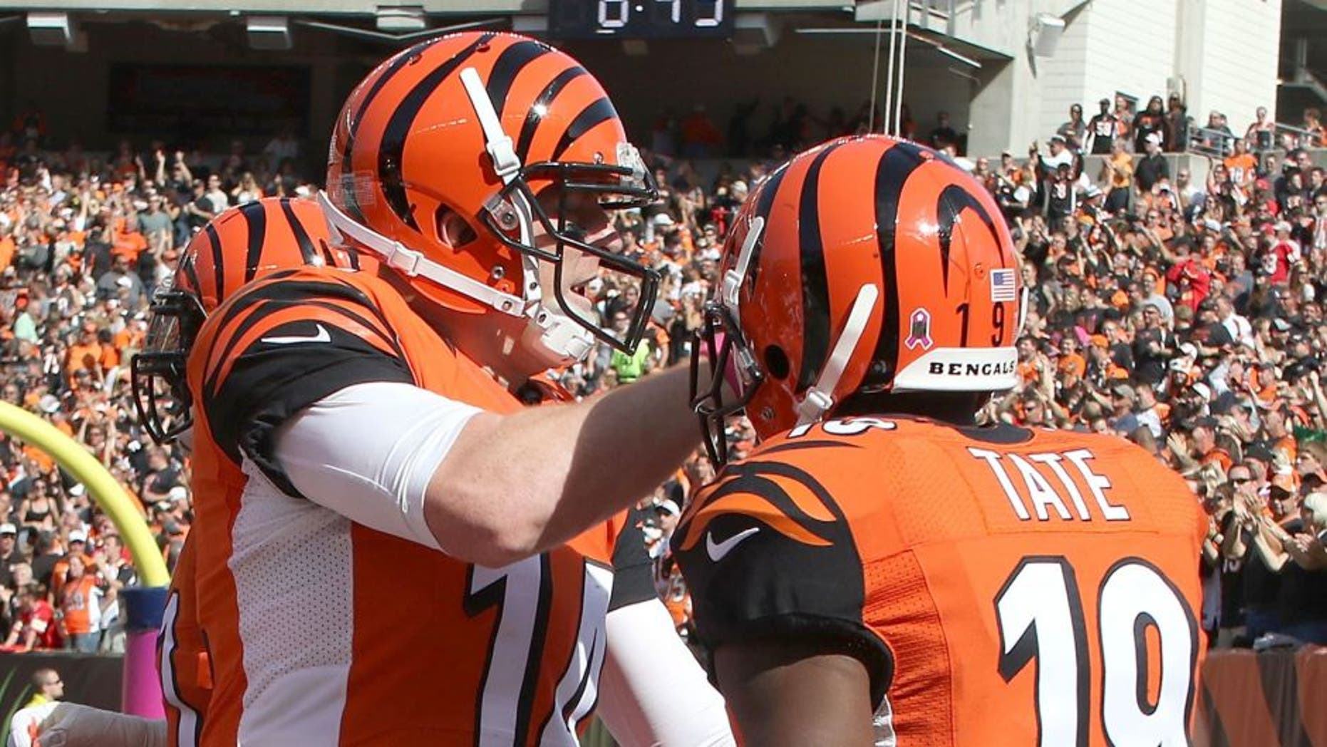 CINCINNATI, OH - OCTOBER 4: Andy Dalton #14 of the Cincinnati Bengals congratulates Brandon Tate #19 of the Cincinnati Bengals after scoring a touchdown on a 55 yard reception during the third quarter of the game against the Kansas City Chiefs at Paul Brown Stadium on October 4, 2015 in Cincinnati, Ohio. (Photo by John Grieshop/Getty Images)