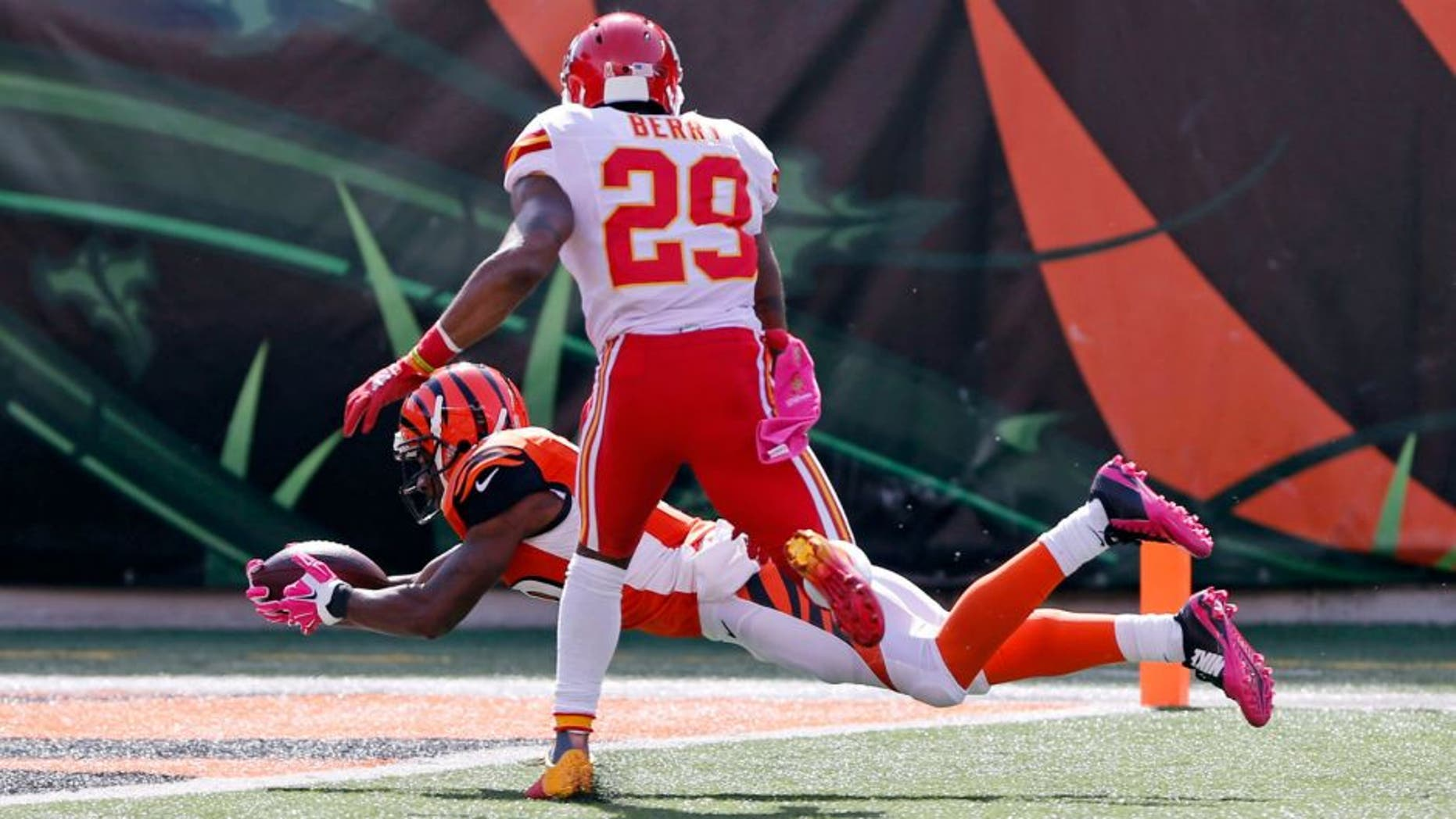Oct 4, 2015; Cincinnati, OH, USA; Cincinnati Bengals wide receiver Brandon Tate (19) makes a catch for a touchdown on a pass from quarterback Andy Dalton (not pictured) as Kansas City Chiefs free safety Eric Berry (29) defends in the second half at Paul Brown Stadium. Mandatory Credit: Aaron Doster-USA TODAY Sports