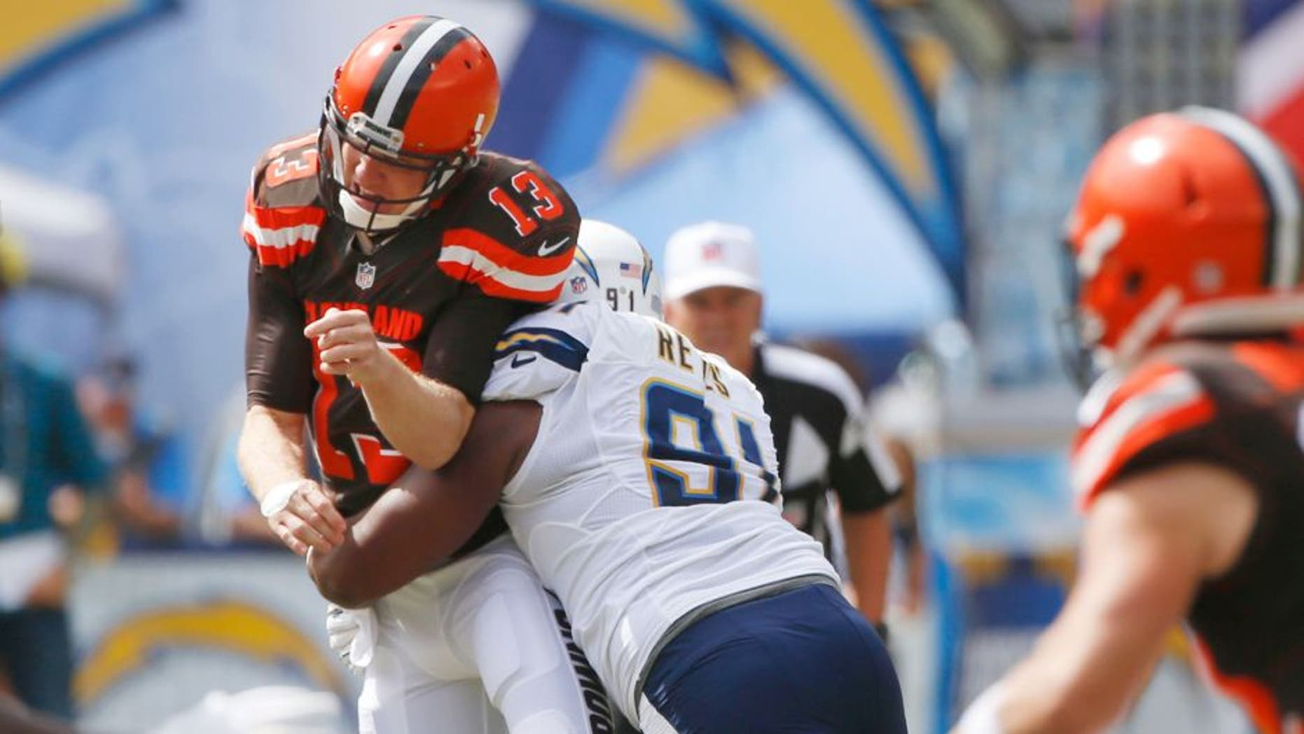 Cleveland Browns quarterback Josh McCown is hit by San Diego Chargers defensive end Kendall Reyes as he throws a pass during the first half in an NFL football game Sunday, Oct. 4, 2015, in San Diego. (AP Photo/Lenny Ignelzi)
