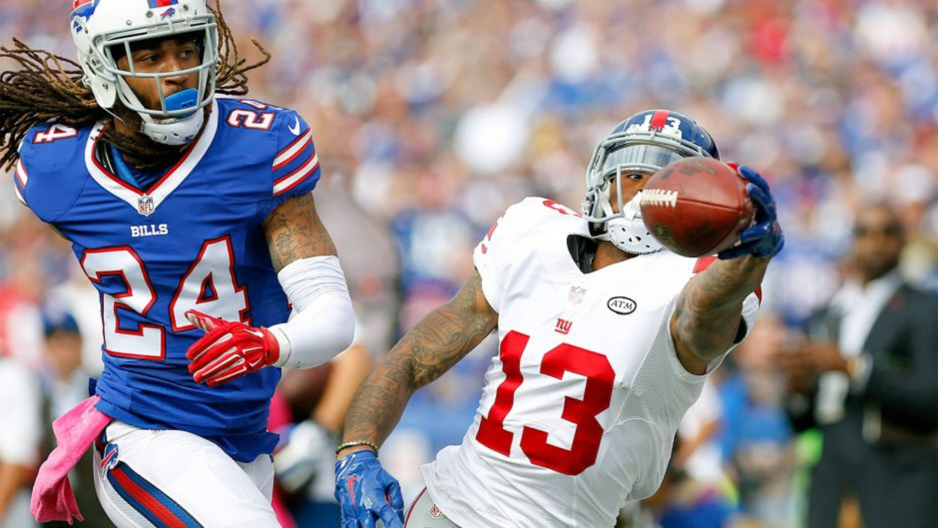 Oct 4, 2015; Orchard Park, NY, USA; New York Giants wide receiver Odell Beckham (13) reaches out but does not make the catch as Buffalo Bills cornerback Stephon Gilmore (24) defends during the first quarter at Ralph Wilson Stadium. Mandatory Credit: Kevin Hoffman-USA TODAY Sports