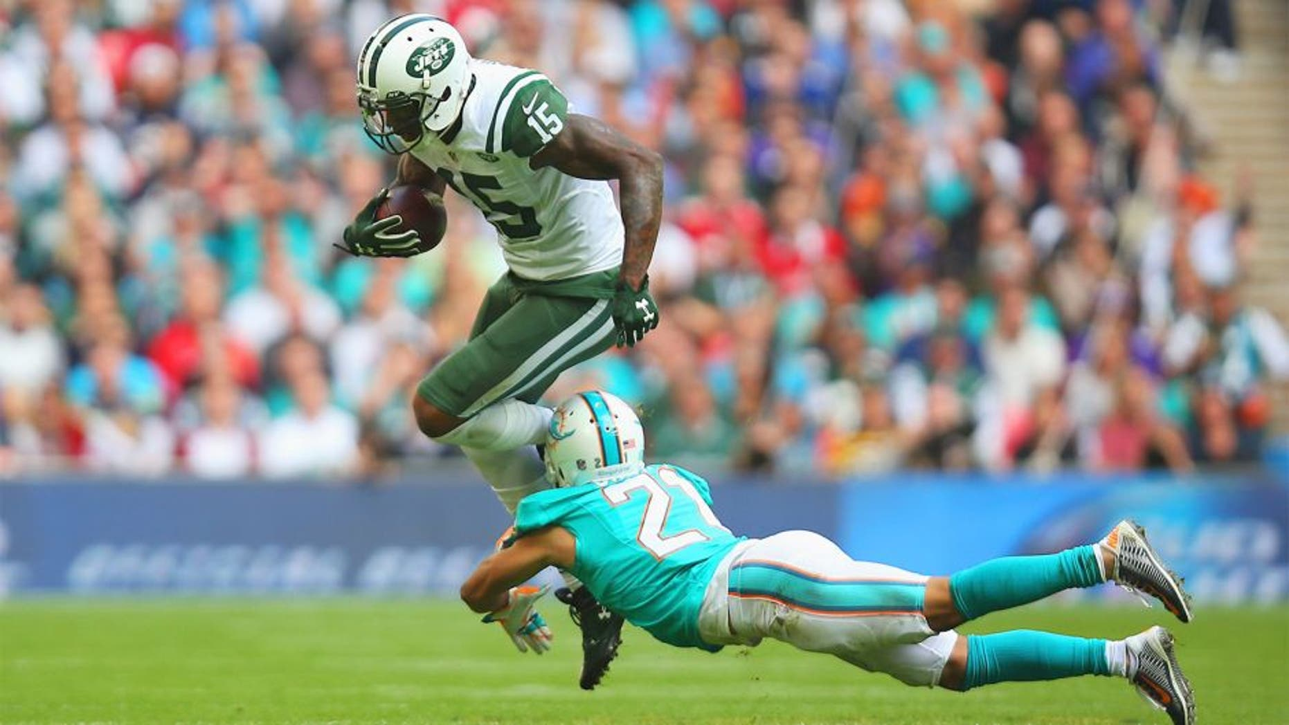 LONDON, ENGLAND - OCTOBER 04: Brandon Marshall #15 of the New York Jets is tackled by Brent Grimes #21 of the Miami Dolphins during the game at Wembley Stadium on October 4, 2015 in London, England. (Photo by Bryn Lennon/Getty Images)