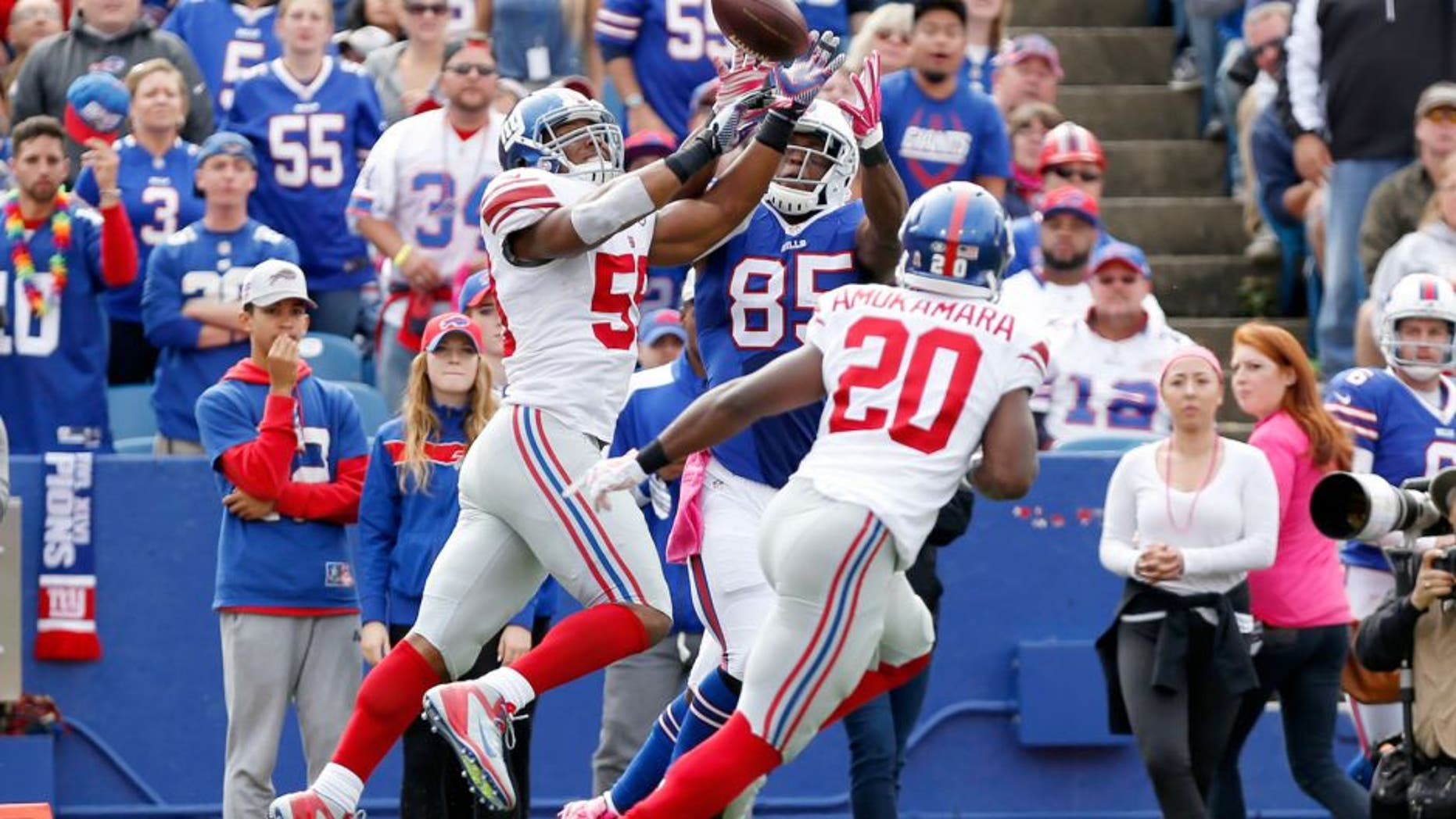 Oct 4, 2015; Orchard Park, NY, USA; New York Giants outside linebacker Devon Kennard (59) intercepts a pass intended for Buffalo Bills tight end Charles Clay (85) during the first half at Ralph Wilson Stadium. Mandatory Credit: Kevin Hoffman-USA TODAY Sports
