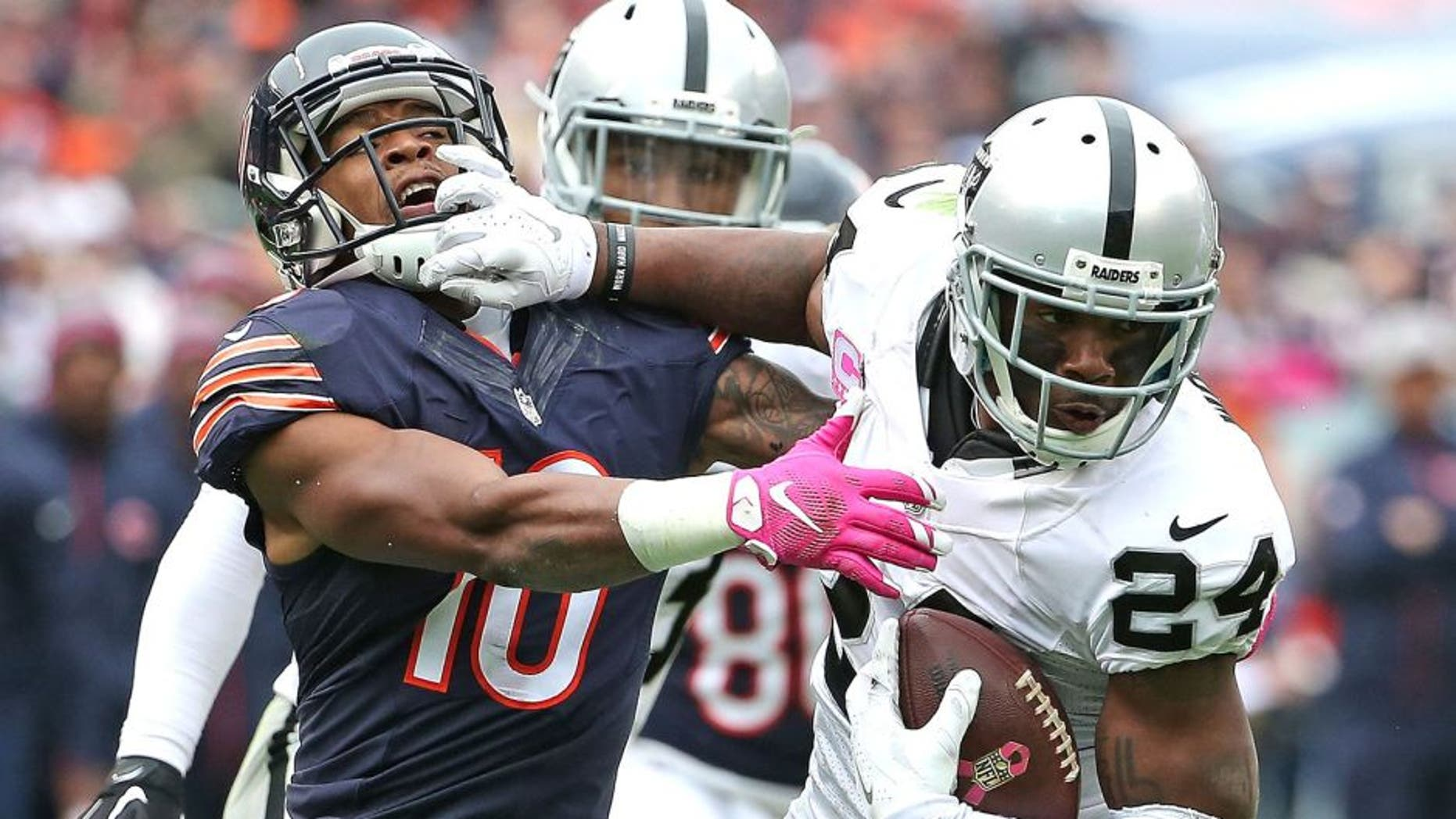 CHICAGO, IL - OCTOBER 04: Charles Woodson #24 of the Oakland Raiders breaks way from Marquess Wilson #10 of the Chicago Bears after intercepting a pass in the 4th quarter at Soldier Field on October 4, 2015 in Chicago, Illinois. The Bears defeated the Raiders 22-20. (Photo by Jonathan Daniel/Getty Images)