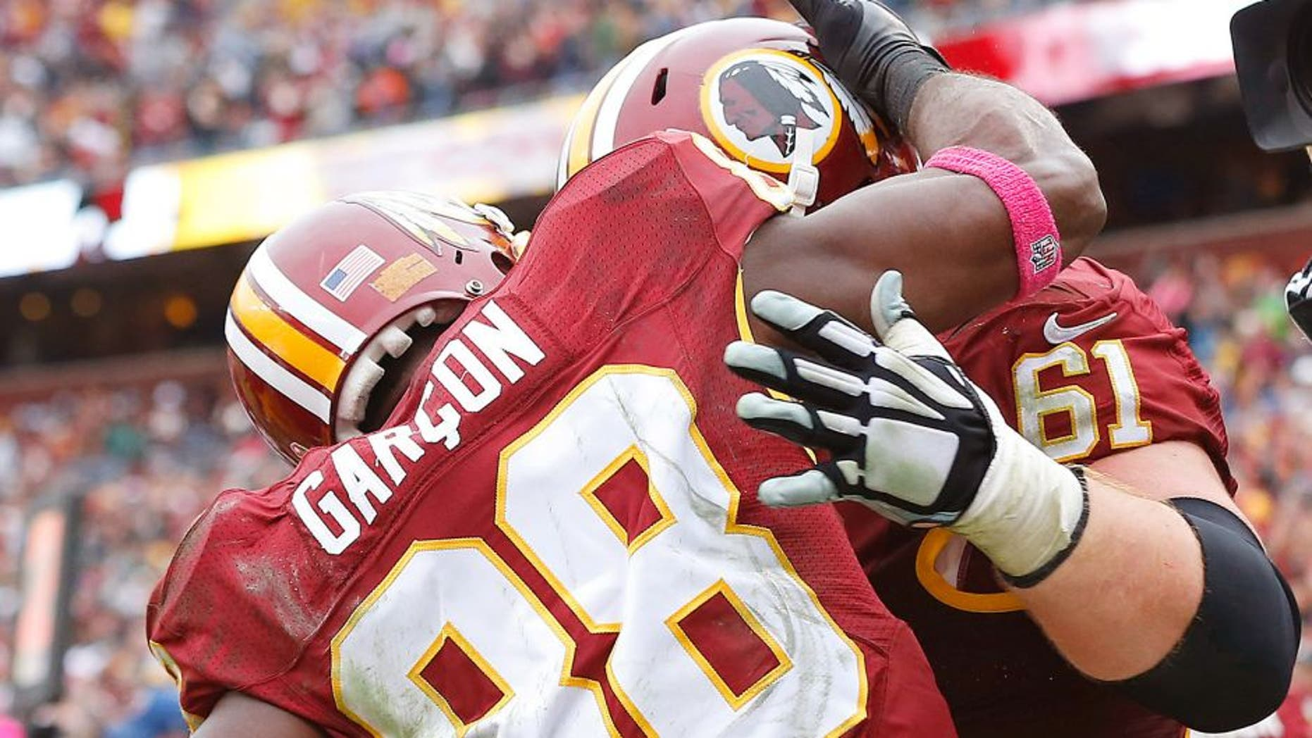 Oct 4, 2015; Landover, MD, USA; Washington Redskins wide receiver Pierre Garcon (88) celebrates with Redskins guard Spencer Long (61) after catching the game winning touchdown pass against the Philadelphia Eagles in the closing seconds of the fourth quarter at FedEx Field. The Redskins won 23-20. Mandatory Credit: Geoff Burke-USA TODAY Sports
